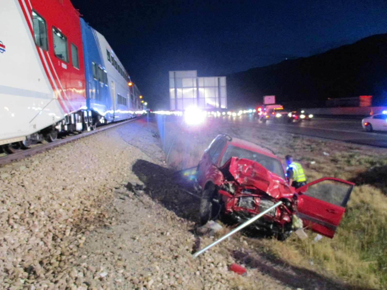 A damaged SUV is pictured after it was hit by a FrontRunner train in Centerville on Wednesday, Oct. 16, 2019. According to the UHP, the driver experienced a medical emergency and drifted off I-15, ending up on the railroad tracks. Trooper Ruben Correa responded to the scene and was able to pull the unconscious driver from the vehicle a second before it was hit by the train.