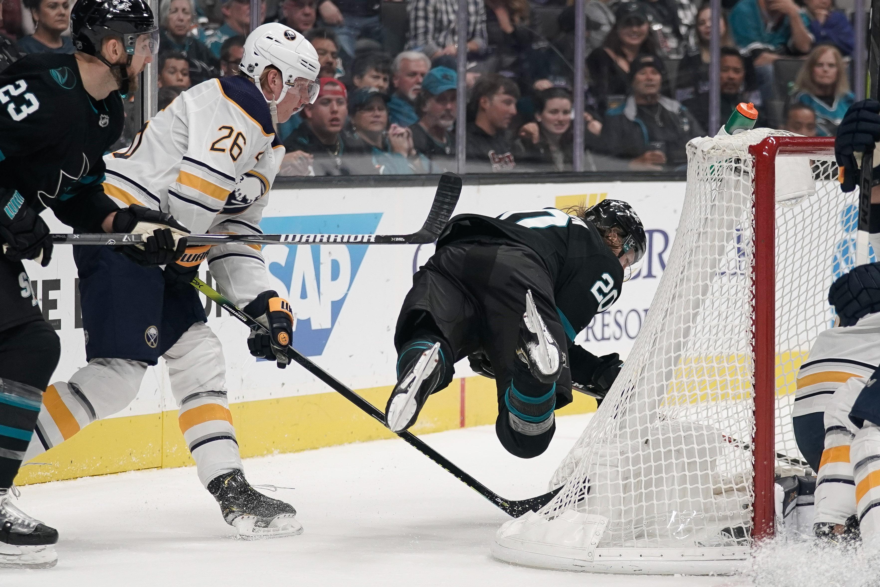 Oct 19, 2019; San Jose, CA, USA; Buffalo Sabres defenseman Rasmus Dahlin (26) trips San Jose Sharks left wing Marcus Sorensen (20) during the second period at SAP Center at San Jose.