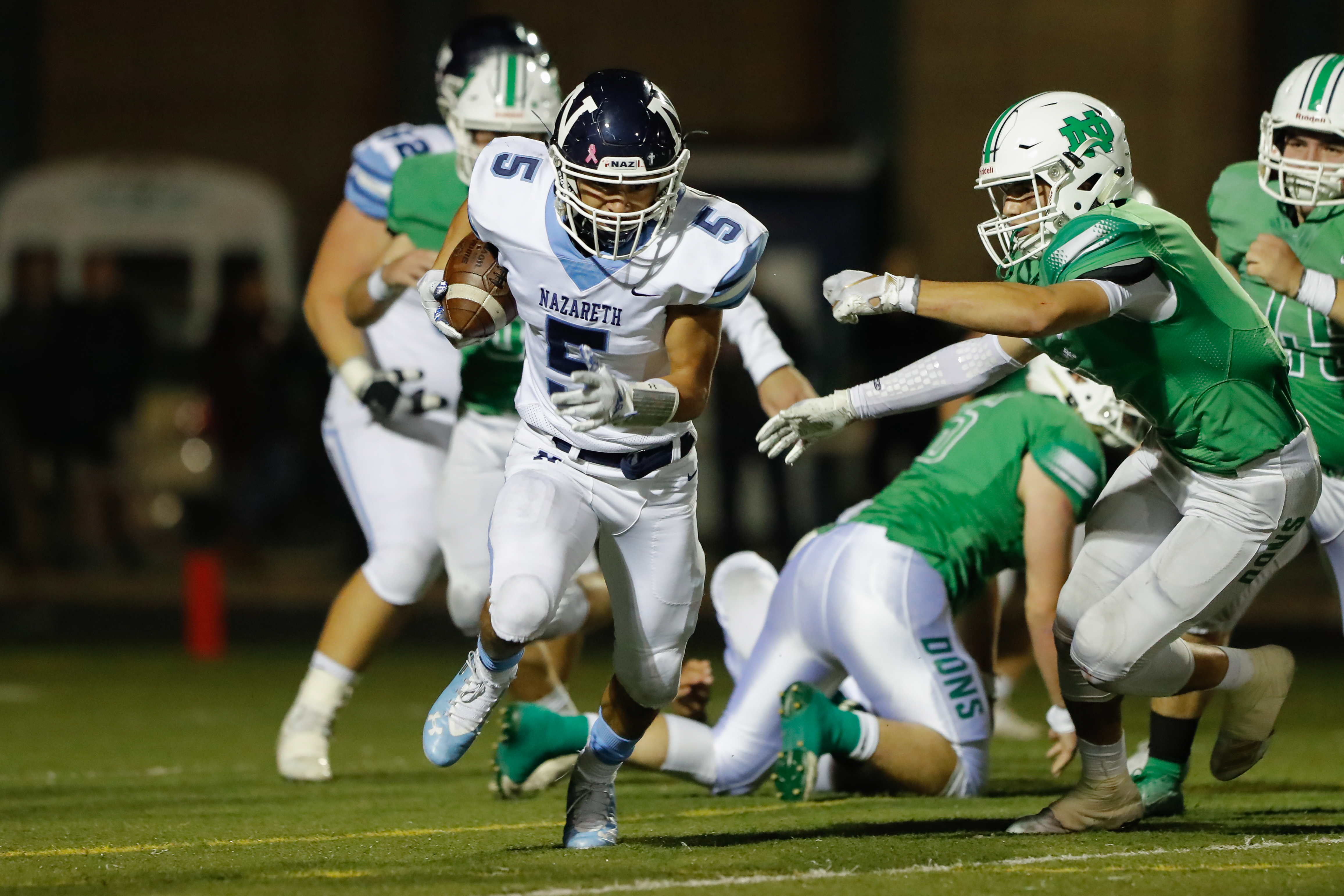 Nazareth's Alex Carrillo (5) runs the ball against Notre Dame.