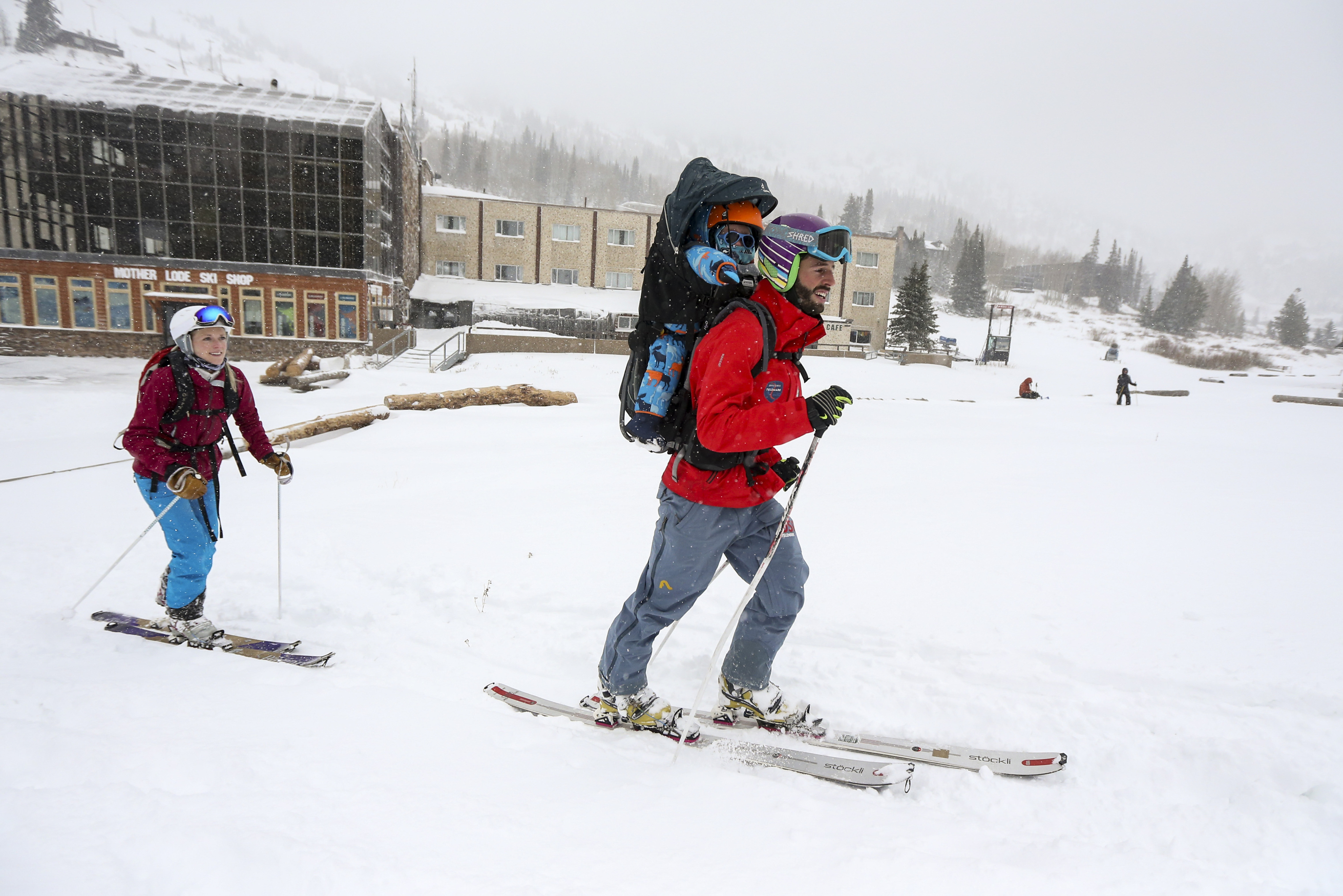 Garrett Long, front, his wife Melind Long and their son Tucker, 17 months, head up the hill from the Wildcat base area at Alta Ski Resort in Little Cottonwood Canyon to enjoy the first substantial snowfall of the year on Sunday, Oct. 20, 2019.