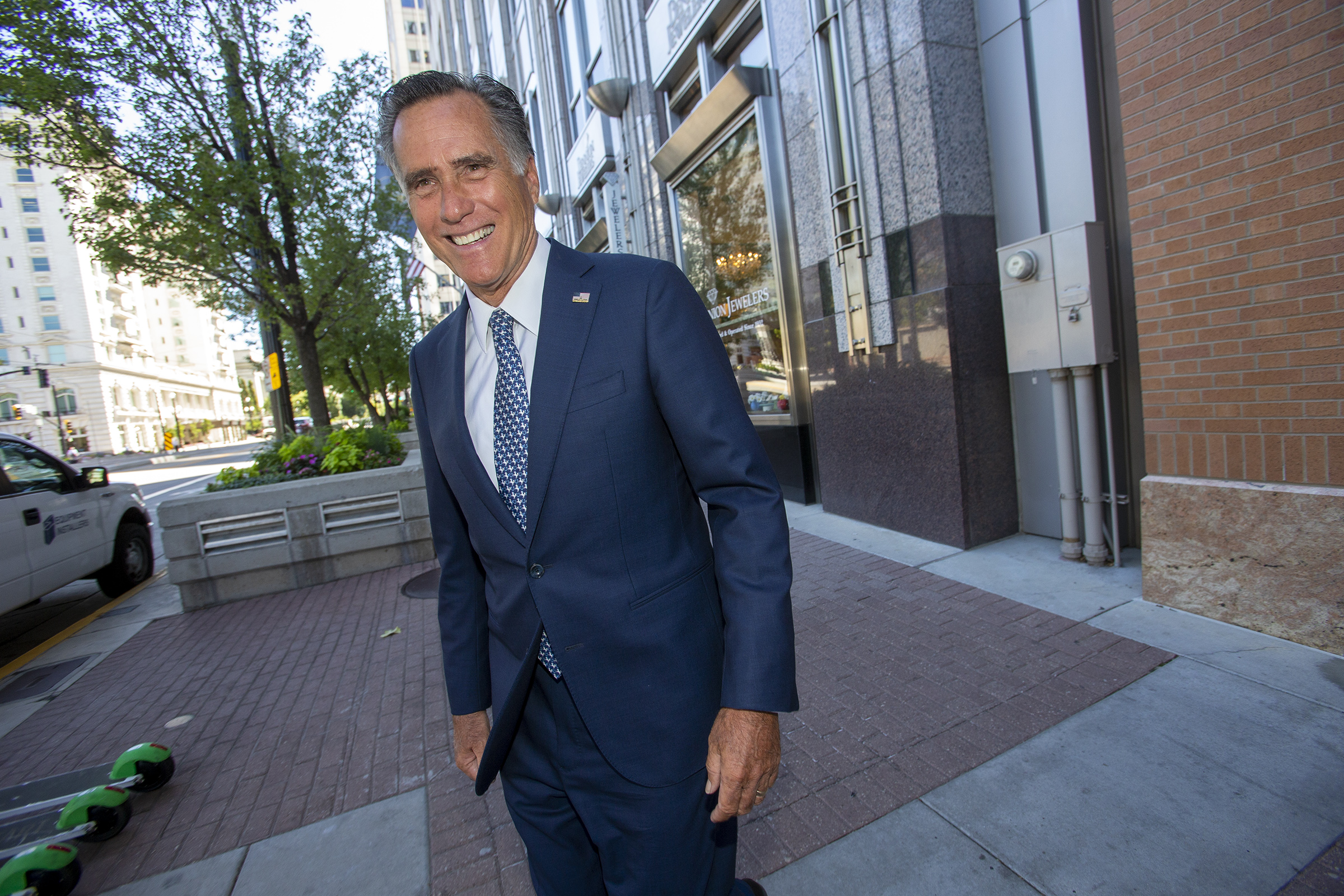FILE - Sen. Mitt Romney, R-Utah, leaves after speaking at the Sutherland Institute in Salt Lake City on Monday, Aug. 19, 2019.