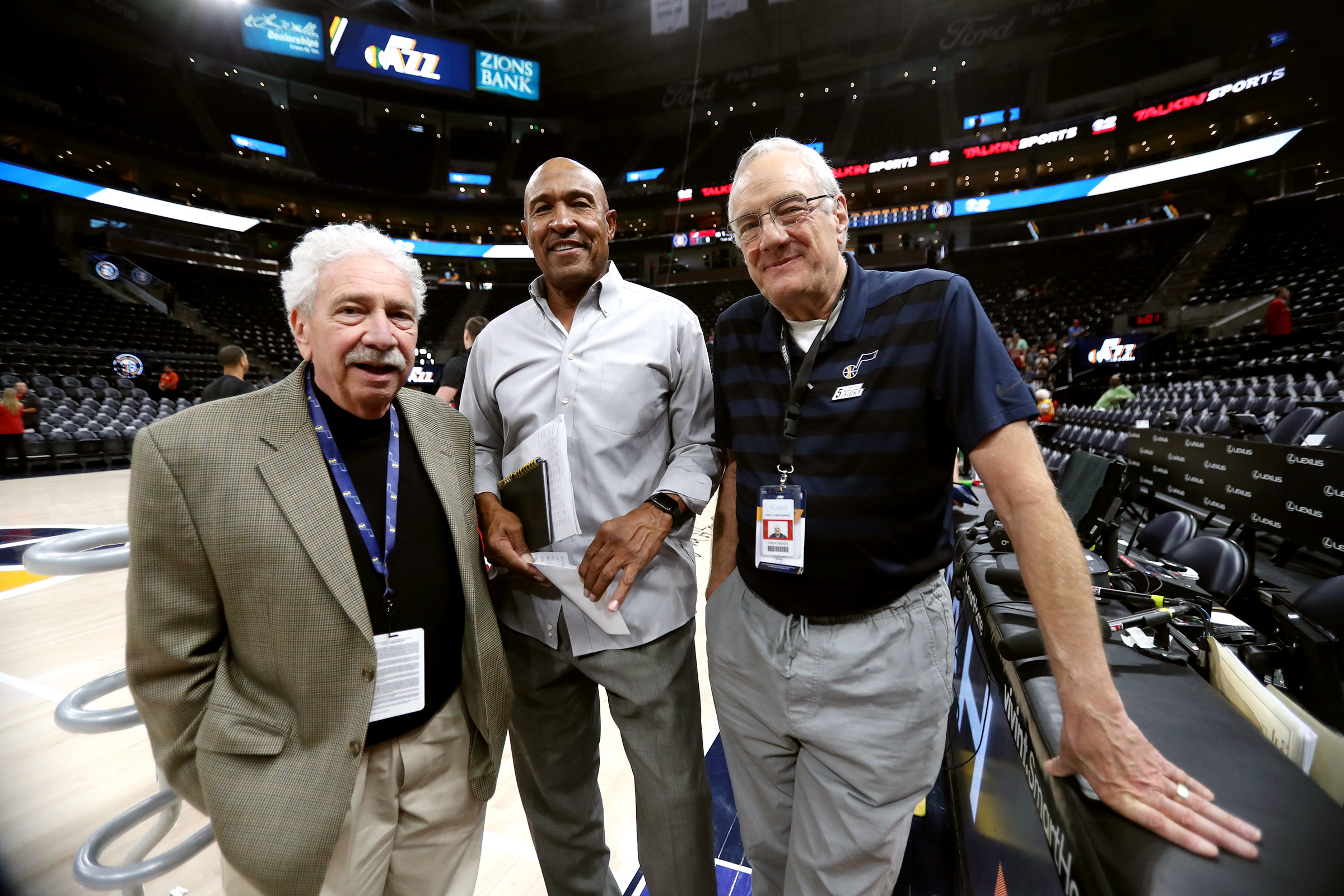 Dave Fredman, Ron Boone and Dan Roberts pose at Vivint Smart Home Arena before a Utah Jazz preseason game in Salt Lake City on Wednesday, Oct. 16, 2019.The three date back to the first Jazz season in 1979-80.