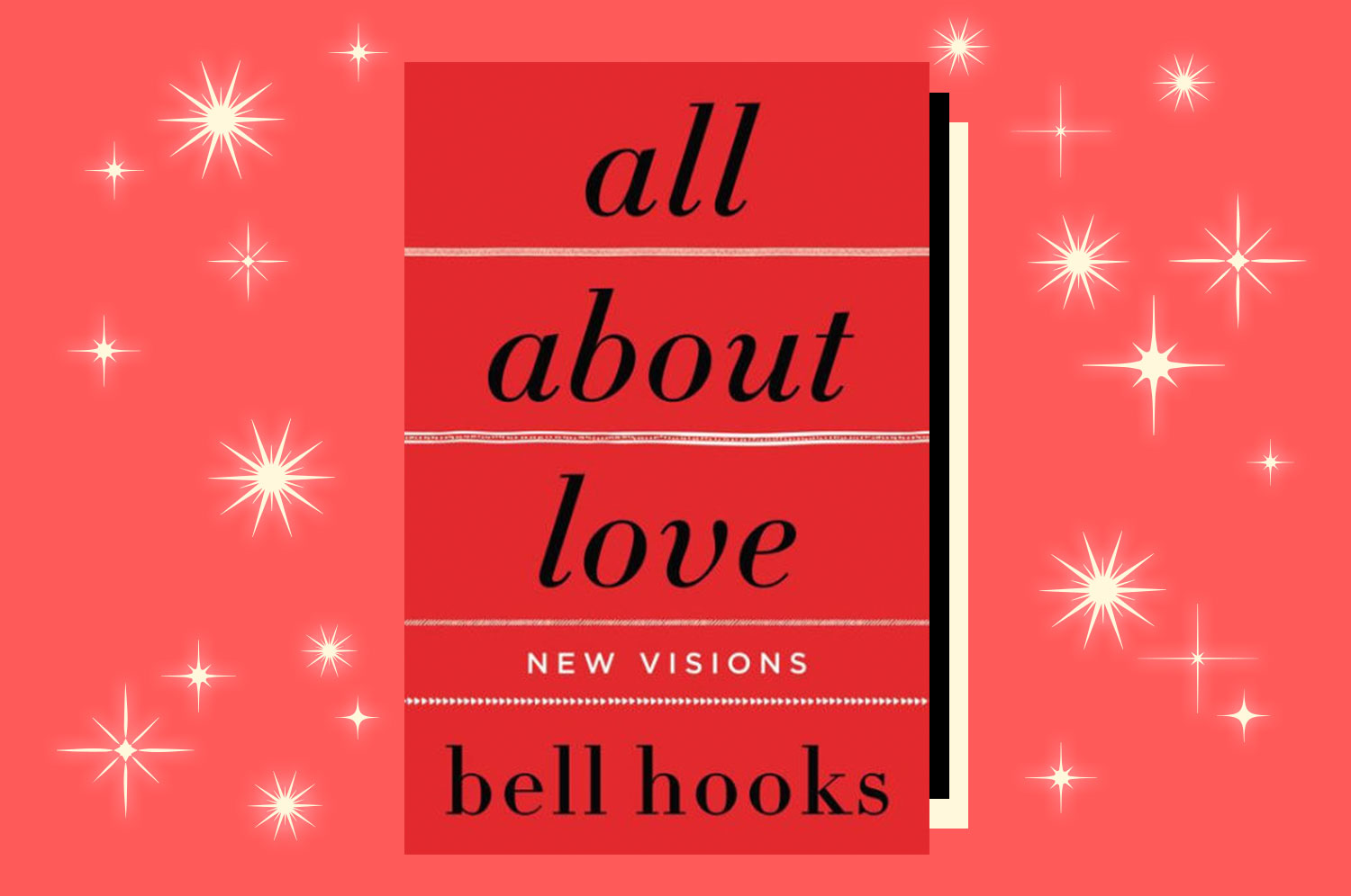 A copy of All About Love by bell hooks on a pink starred background