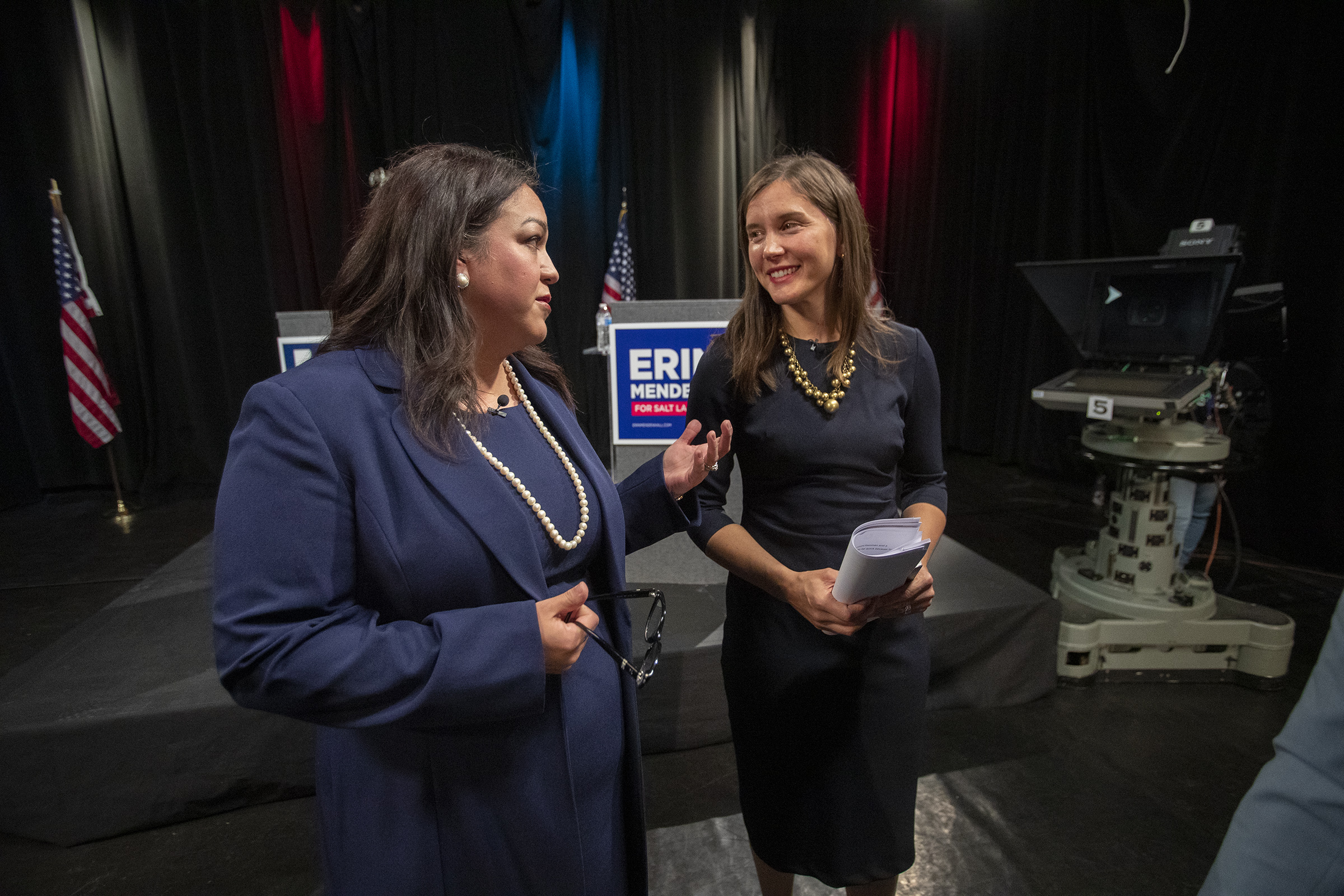 Salt Lake City mayoral candidates Luz Escamilla and Erin Mendenhall chat as they walk off the stage following a televised debate at the Triad Center in Salt Lake City on Monday, Oct. 21, 2019.