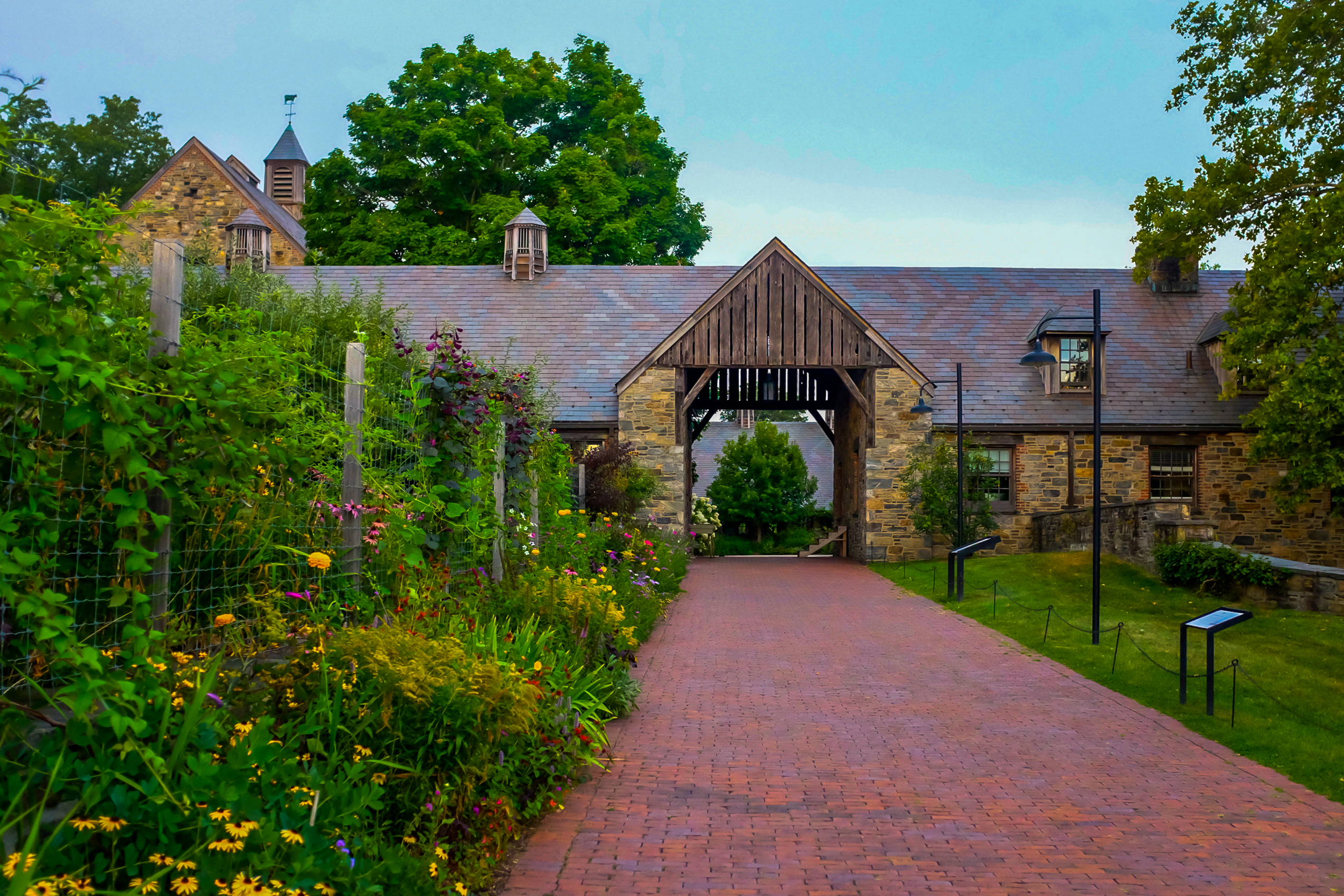 Blue Hill at Stone Barns has lush greenery and a stone building