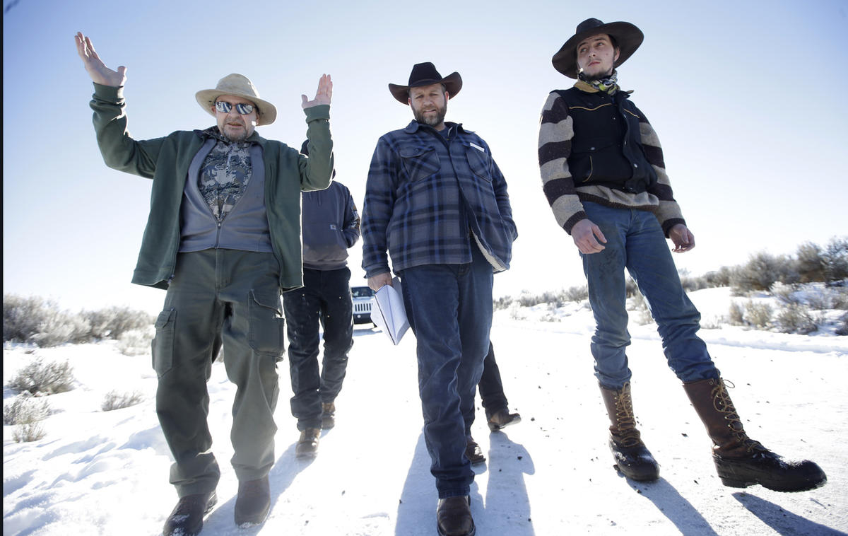 FILE - In this Jan 8, 2016, file photo, Burns resident Steve Atkins, left, talks with Ammon Bundy, center, one of the sons of Nevada rancher Cliven Bundy, following a news conference at Malheur National Wildlife Refuge near Burns, Ore.
