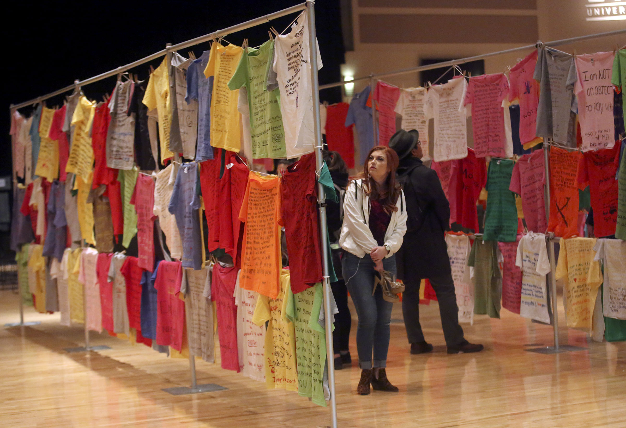 McKenzie Jensen explores the Clothesline Project at Utah Valley University in Orem on Wednesday, Oct. 31, 2018.