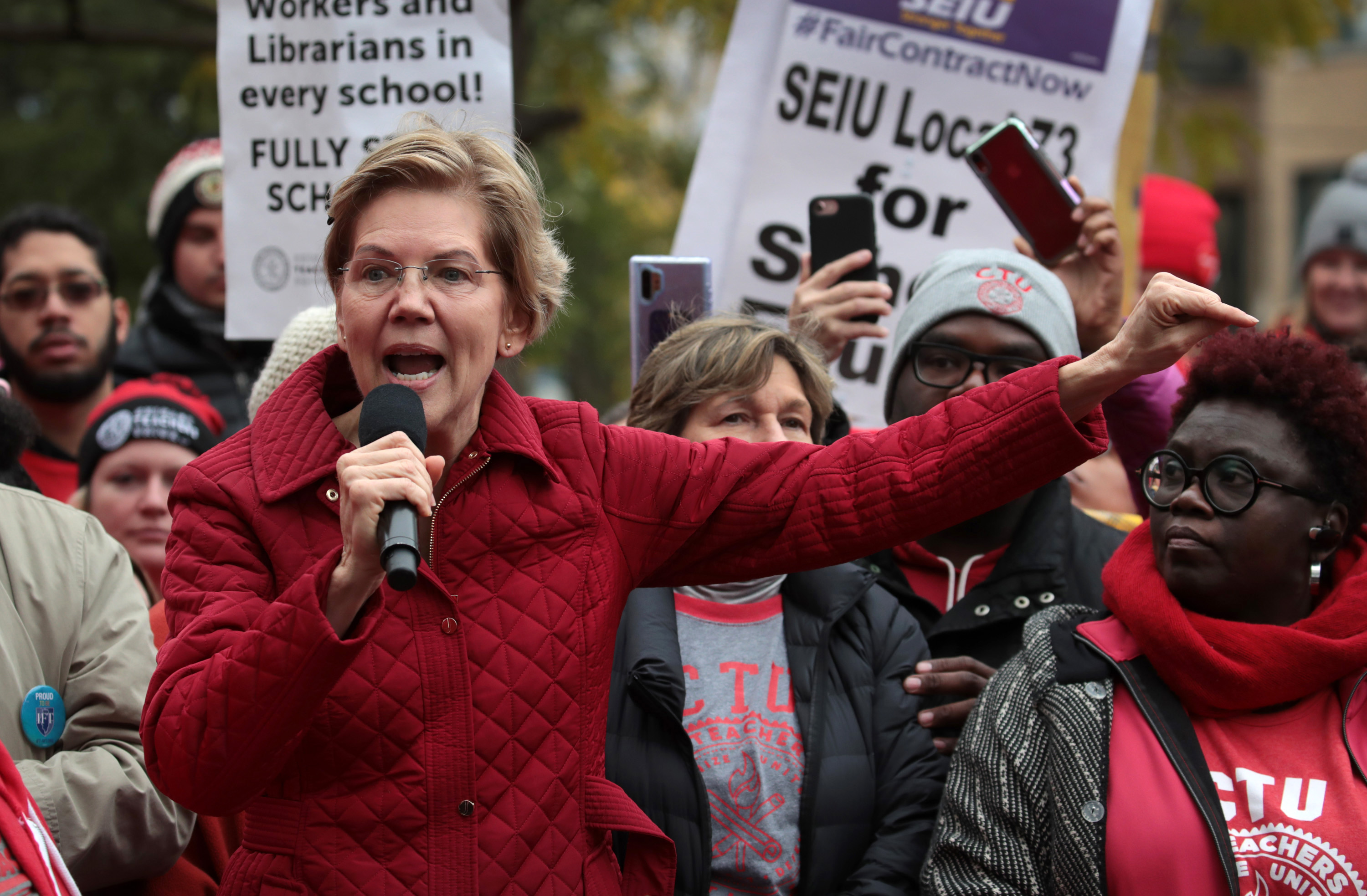 Elizabeth Warren marches with striking Chicago teachers, a day after releasing new K-12 education plan
