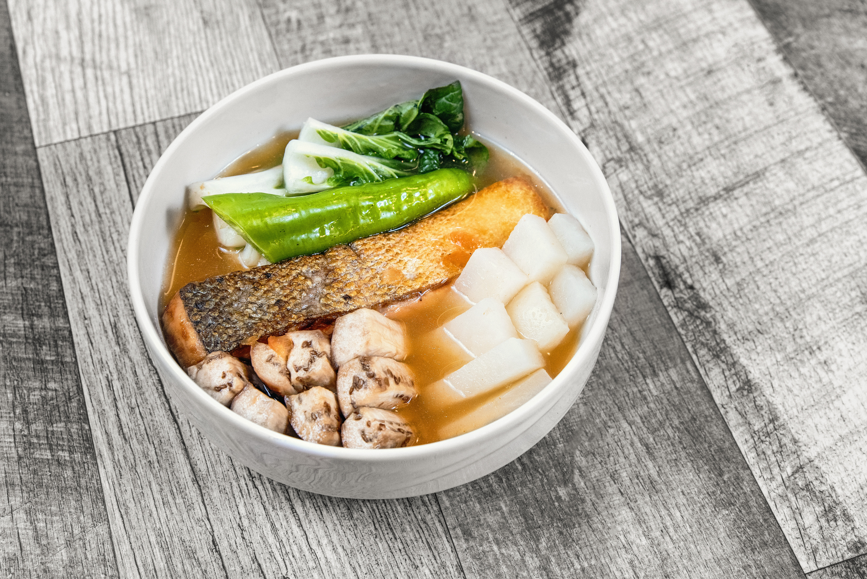 Sinigang (tamarind soup with salmon, eggplant, daikon, and bok choy) from Tsismis