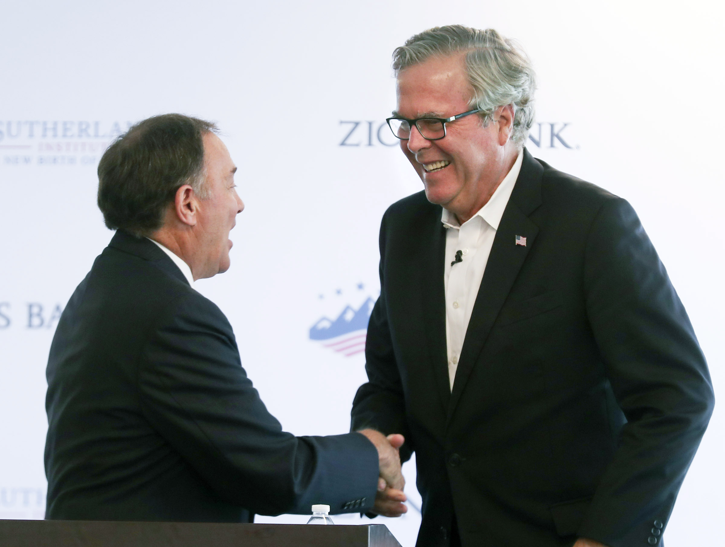 Gov. Gary Herbert, left, shakes hands with former Florida Gov. Jeb Bush, right, after Herbert introduced Bush at the Sutherland Institute in Salt Lake City on Tuesday, Oct. 22, 2019. Bush talked about the state of education in America and about policies that have the potential to provide innovation in the Utah education system.