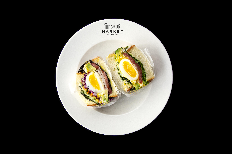 An egg sandwich on a white plate.