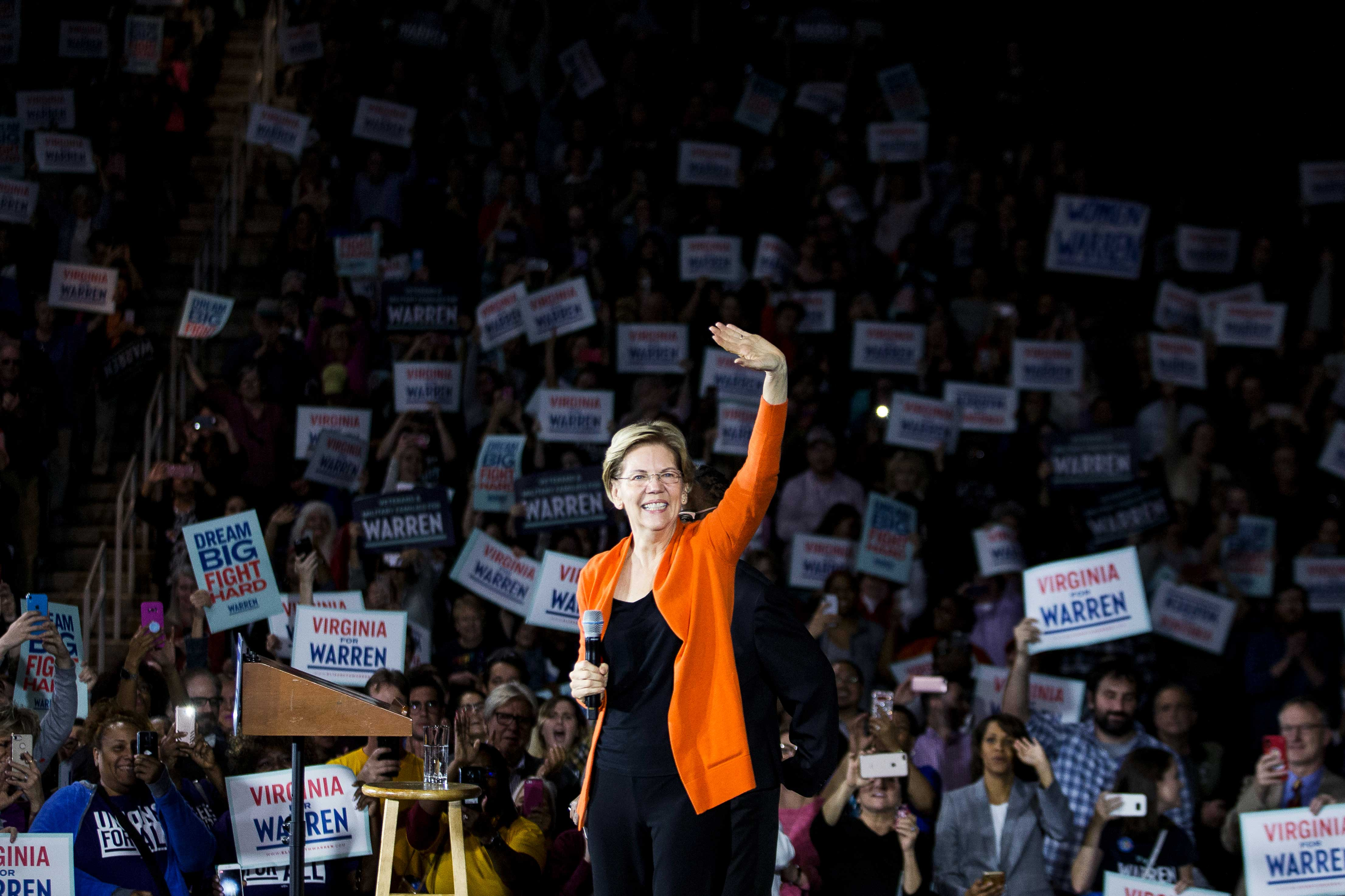 Senator Elizabeth Warren takes the stage during a town hall event in Norfolk, Virginia, on October 18, 2019.