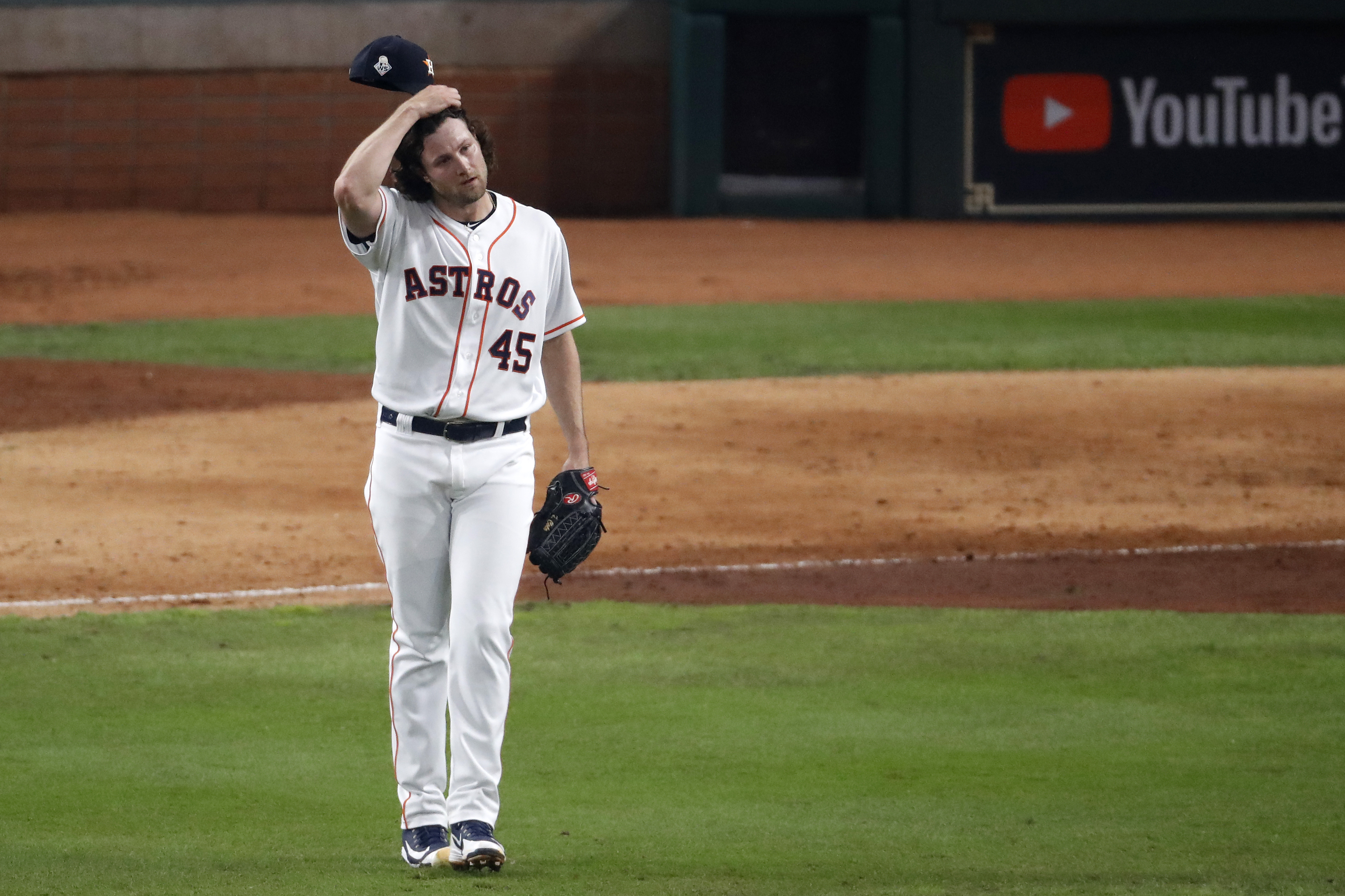 Houston Astros pitcher Gerrit Cole reacts after allowing an RBI double to Juan Soto of the Nationals in the World Series. Yikes!