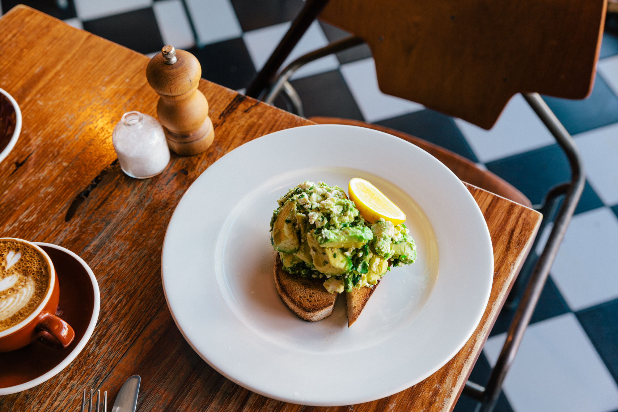An avocado toast sits on a table at Batch in Melbourne