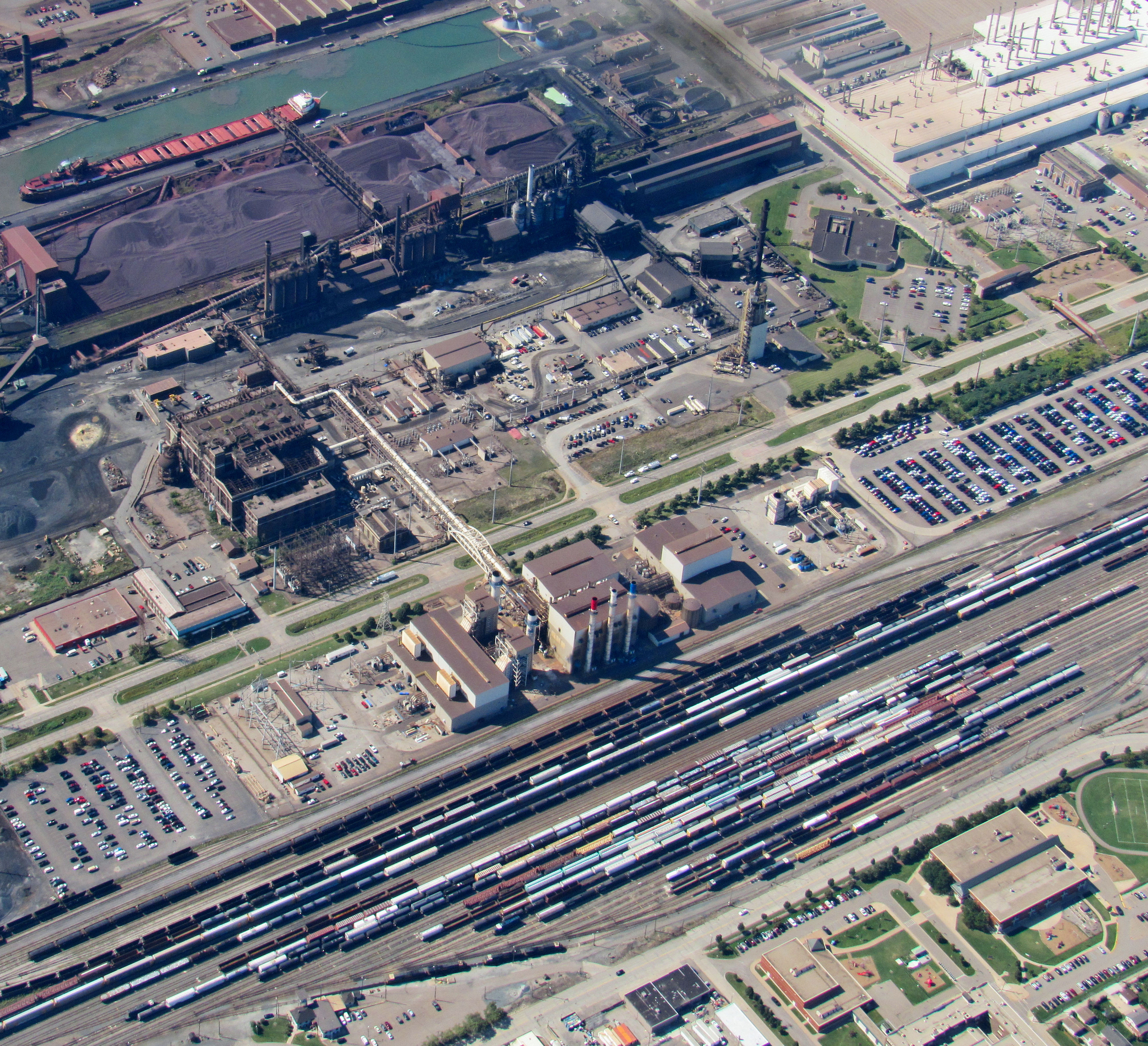 Aerial view of an industrial park with factories and a rail yard.