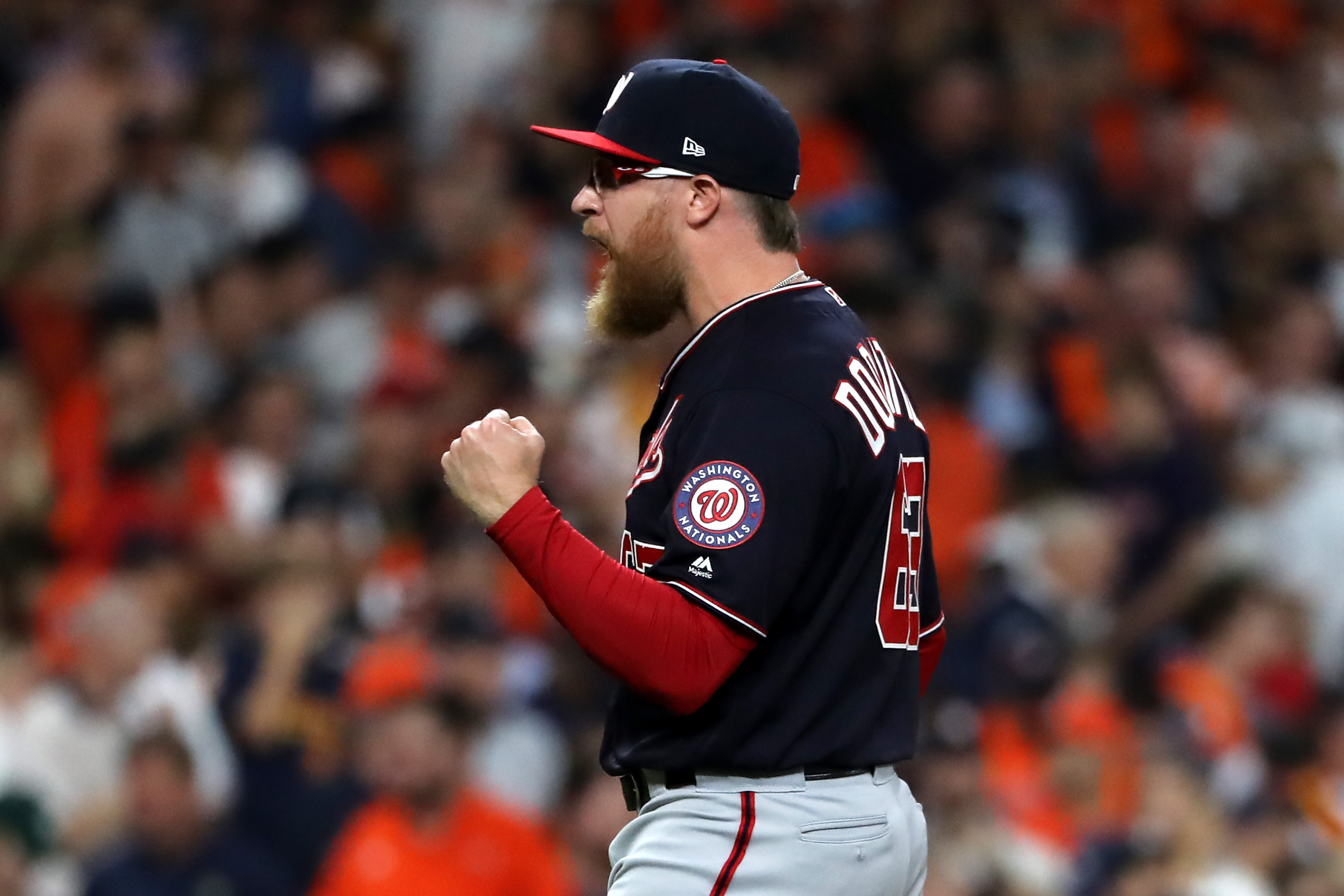 Nationals' Sean Doolittle celebrates getting the save in Game 1 of the World Series against the Houston Astros.