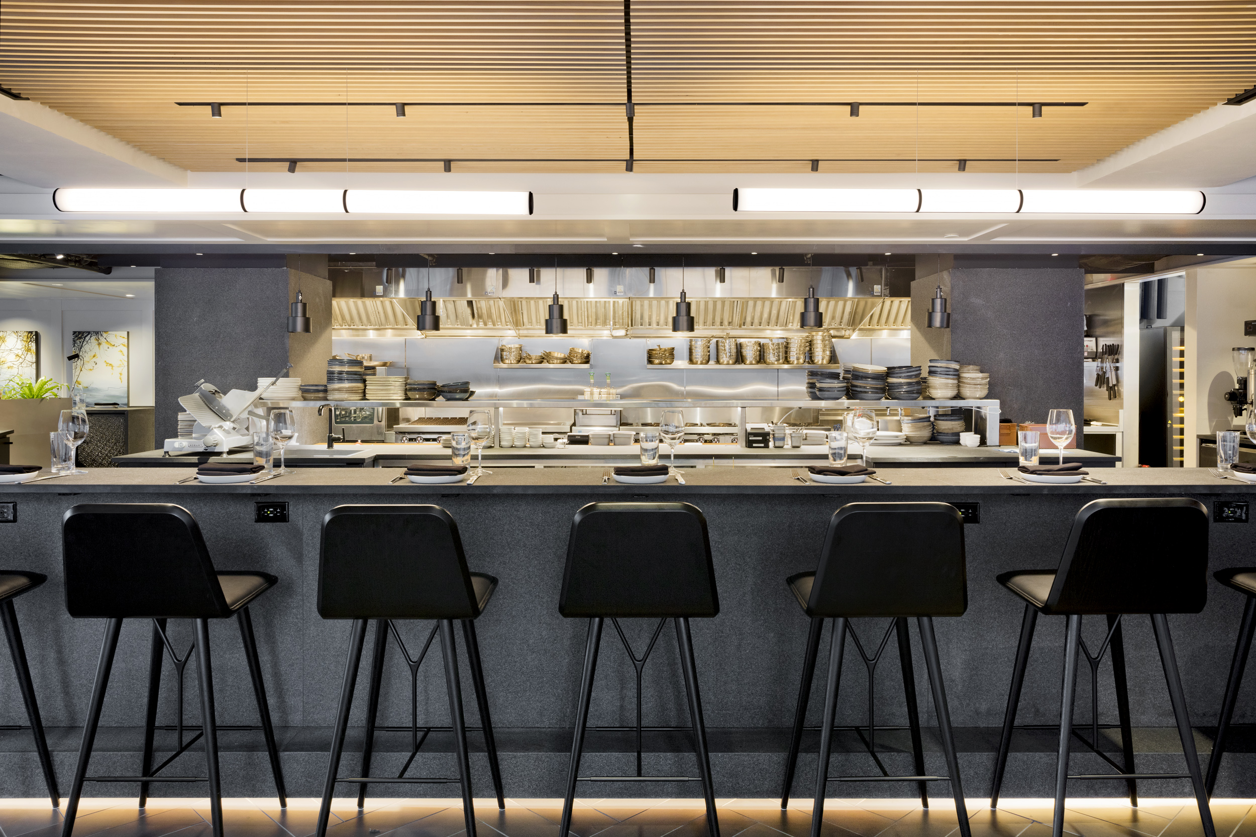 Wolf's open kitchen with black stool seating