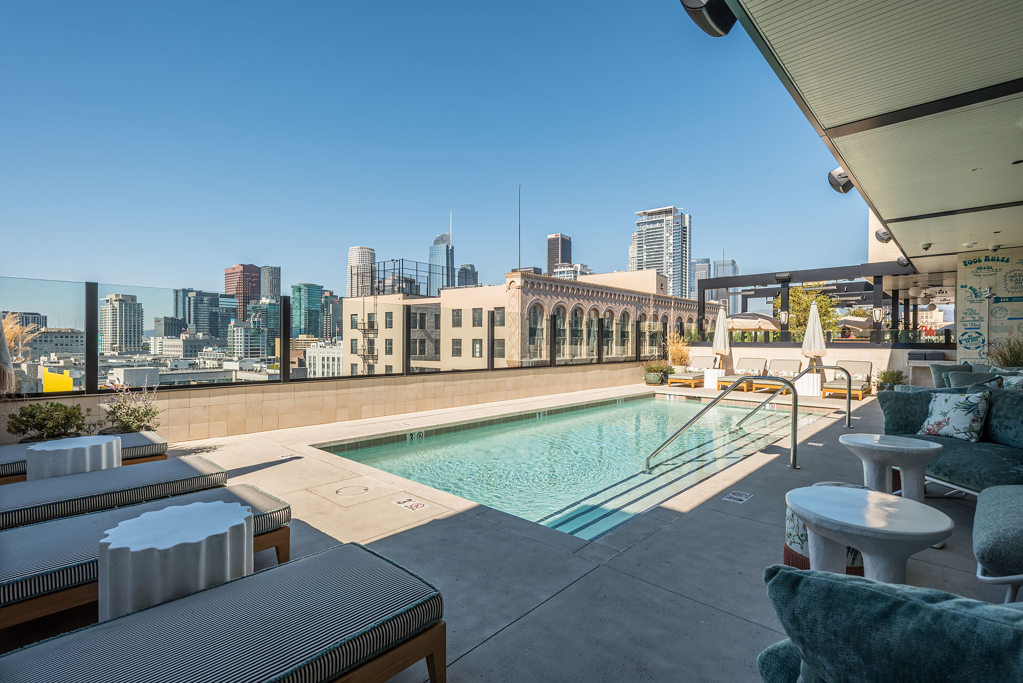 A rectangular rooftop pool overlooking Los Angeles.