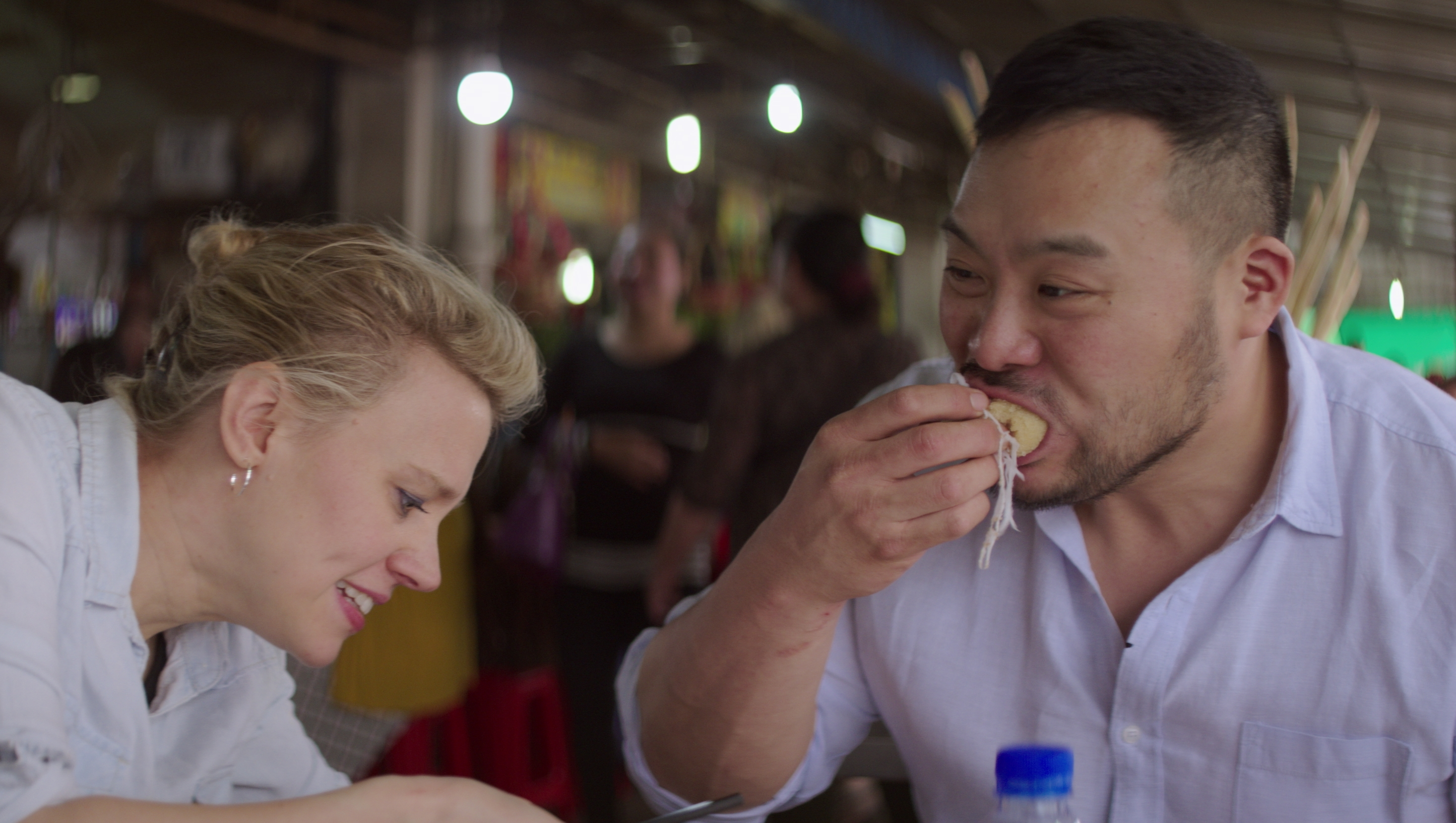 David Chang and Kate McKinnon eating street food in Phnom Penh, Cambodia.