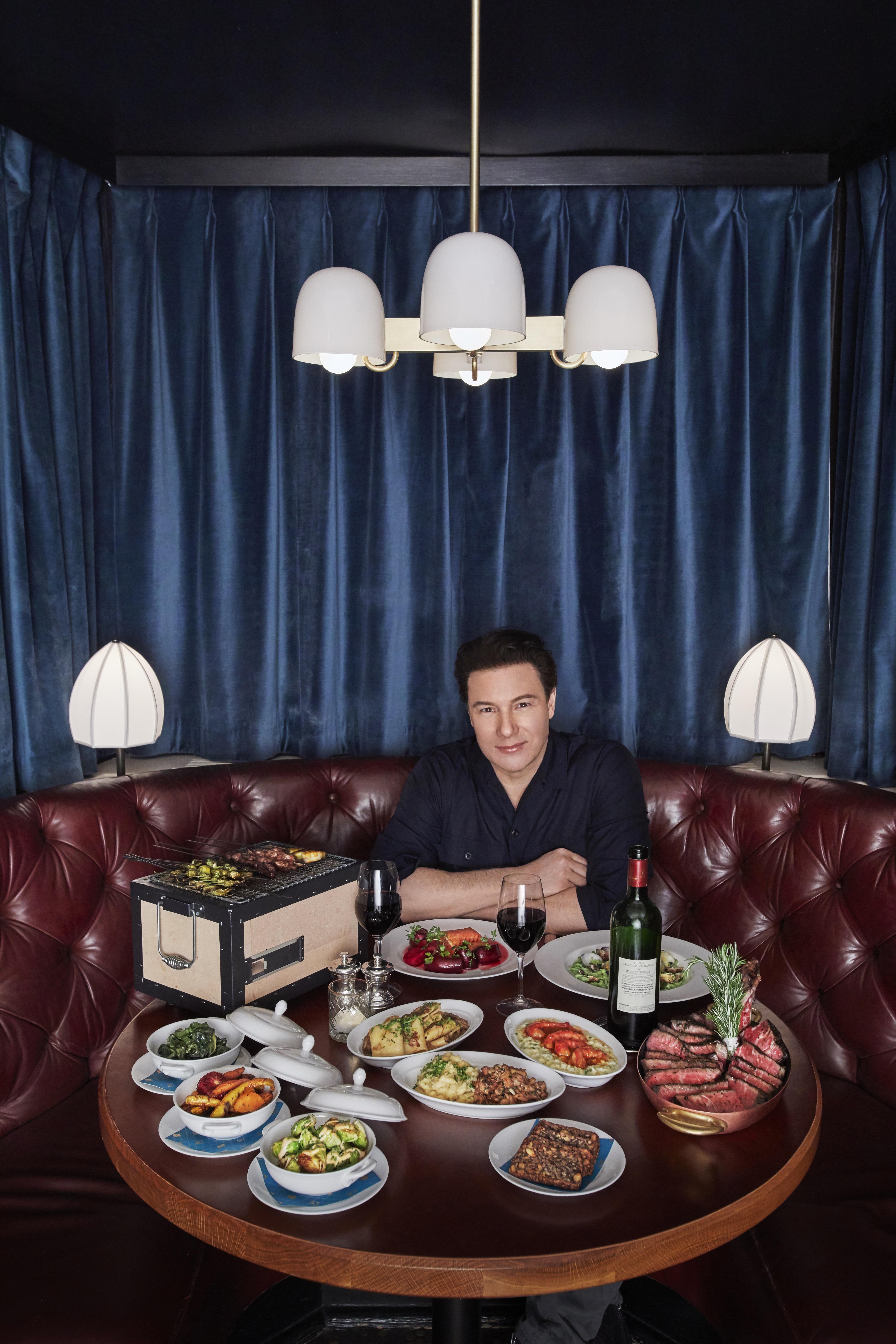 Rocco DiSpirito, a booth, a binchotan box