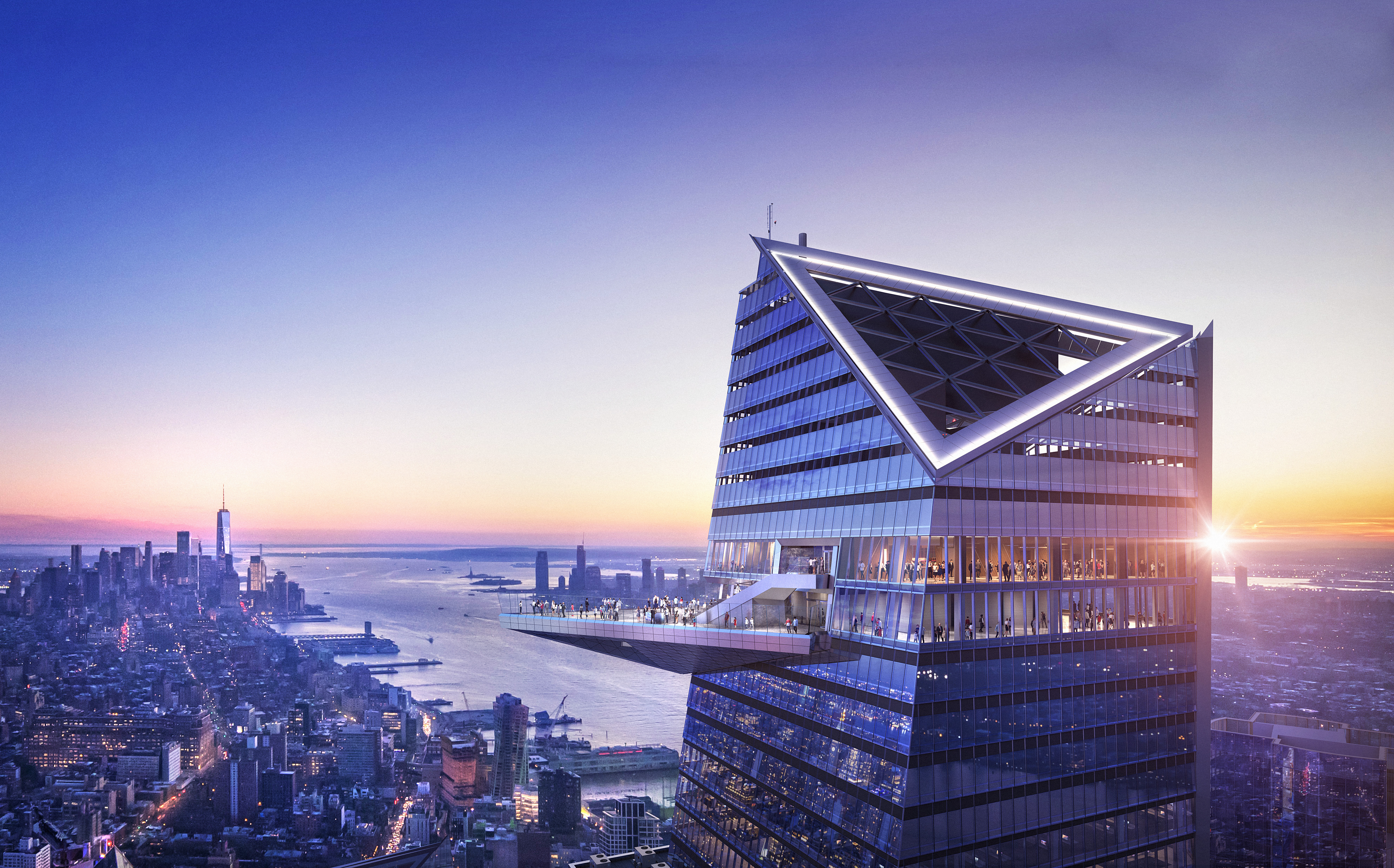 The triangular shaped observation deck at 30 Hudson Yards during the sunset, with views towards the Hudson River and Lower Manhattan.