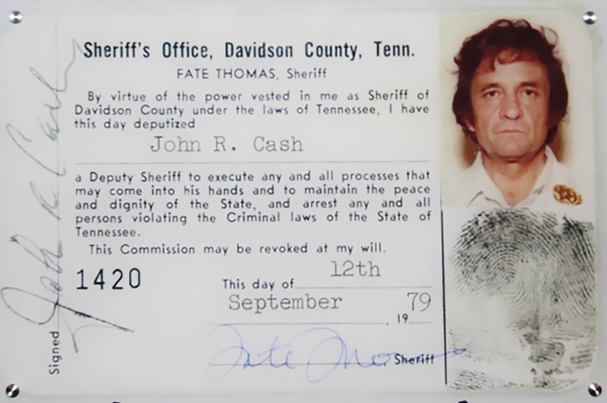 Shows Cash's Deputy Sheriff ID card.