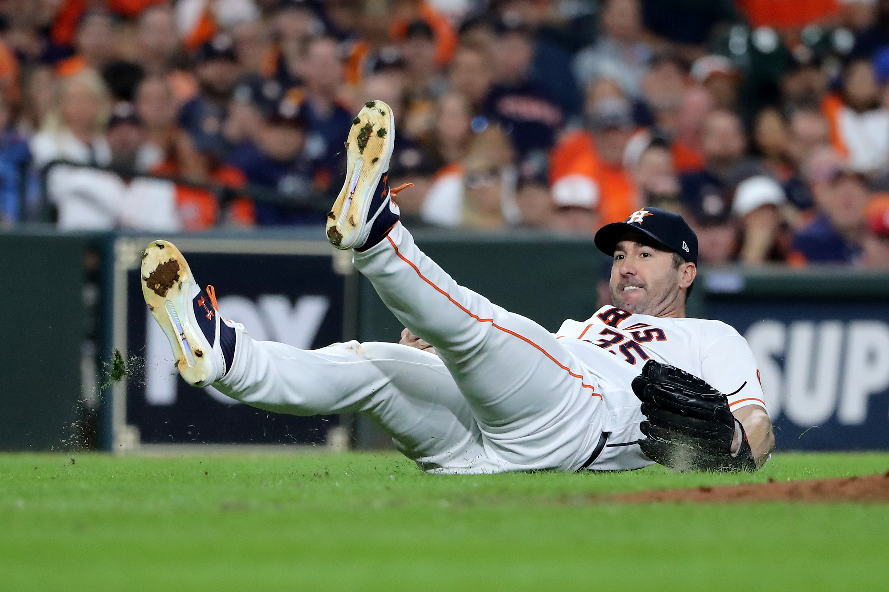 Justin Verlander of the Houston Astros fails to field a ground ball against the Washington Nationals during the fourth inning in Game Two of the 2019 World Series at Minute Maid Park on October 23, 2019 in Houston, Texas.