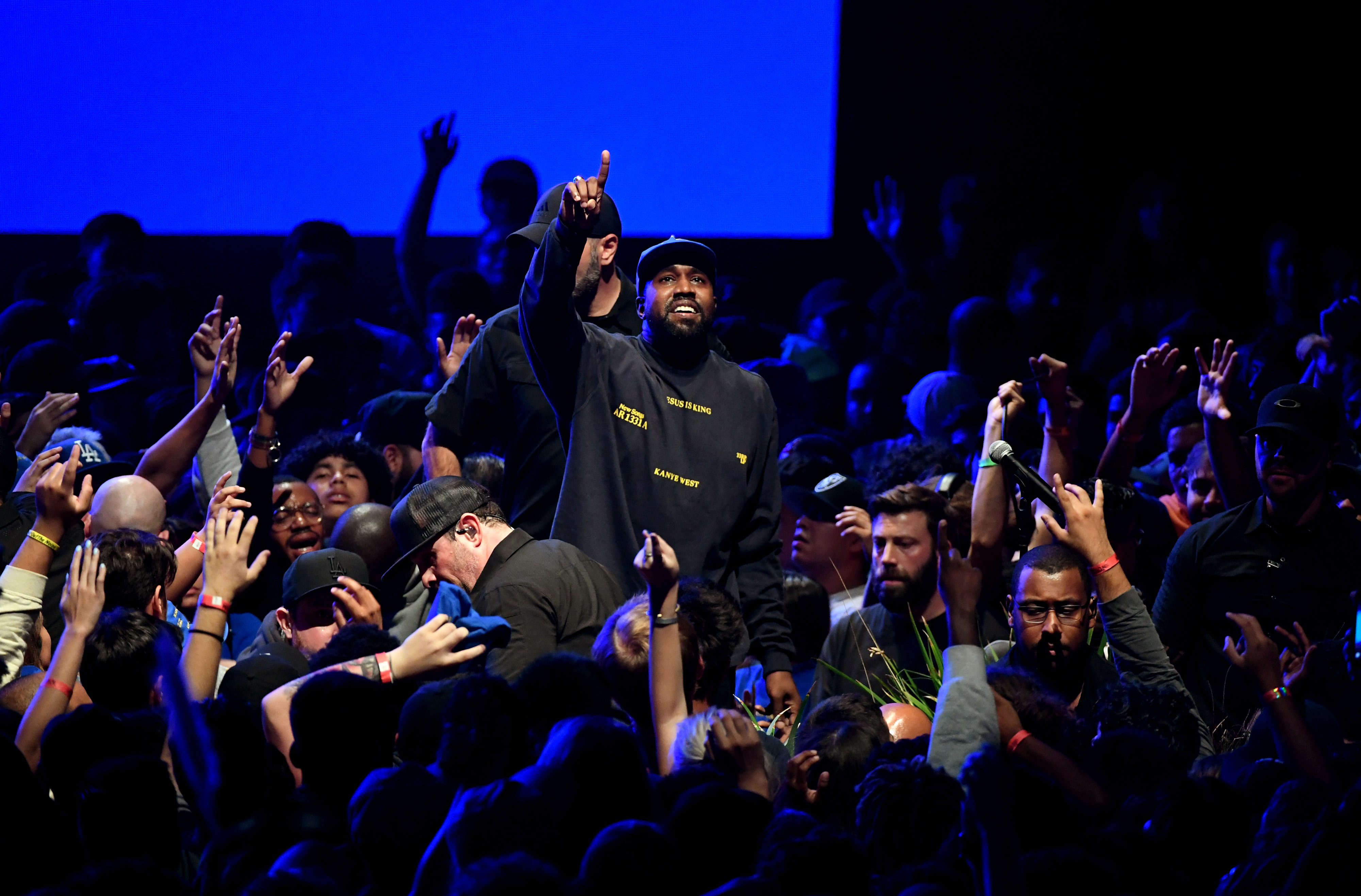 Rapper Kanye West performs amid a crowd of fans at a performance in Southern California.
