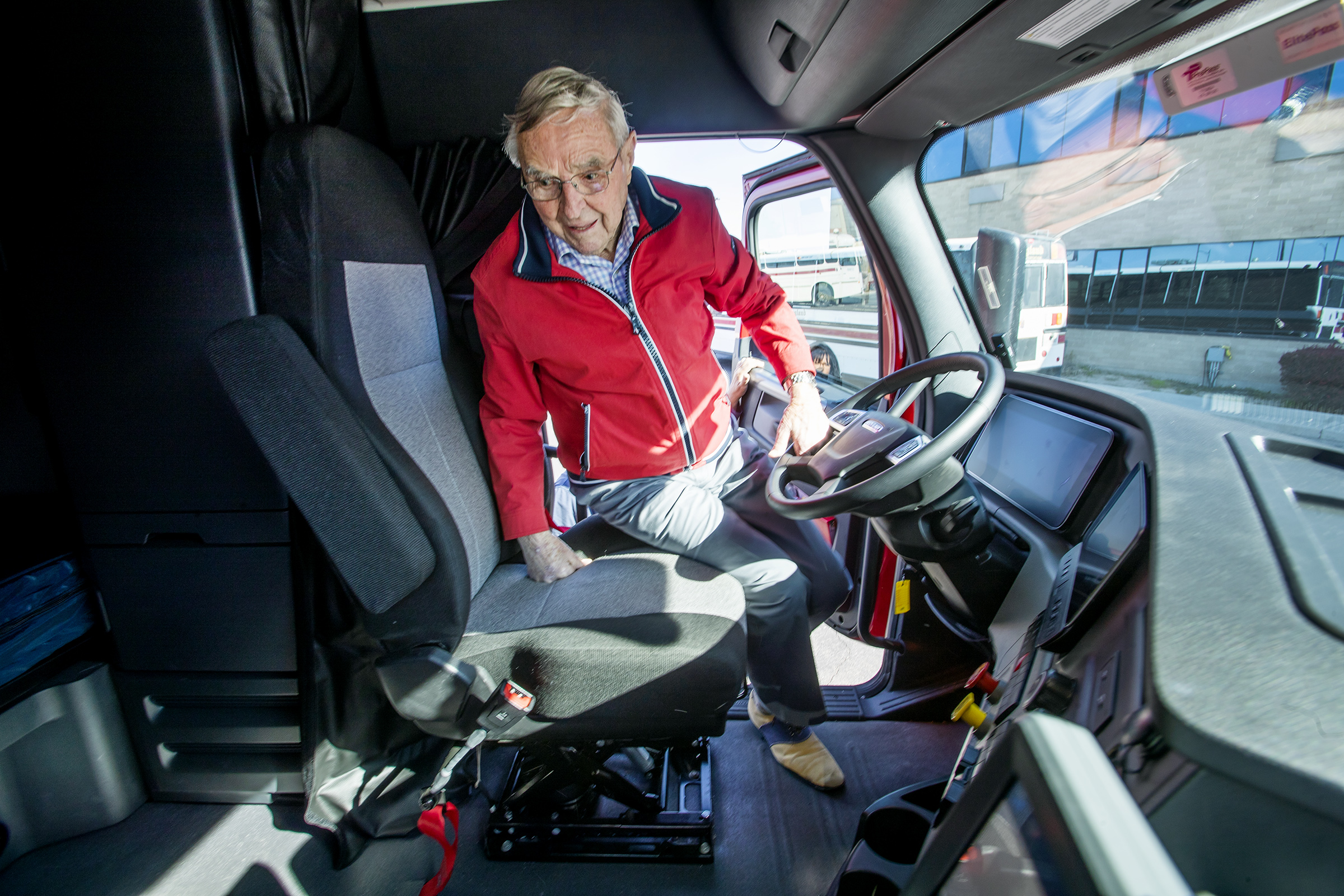 Gene England, president emeritus of C.R.England, climbs into the cab of a new truck at the company's headquarters in West Valley City on Monday, Oct. 14, 2019. England will be 100 on Oct. 24, 2019.