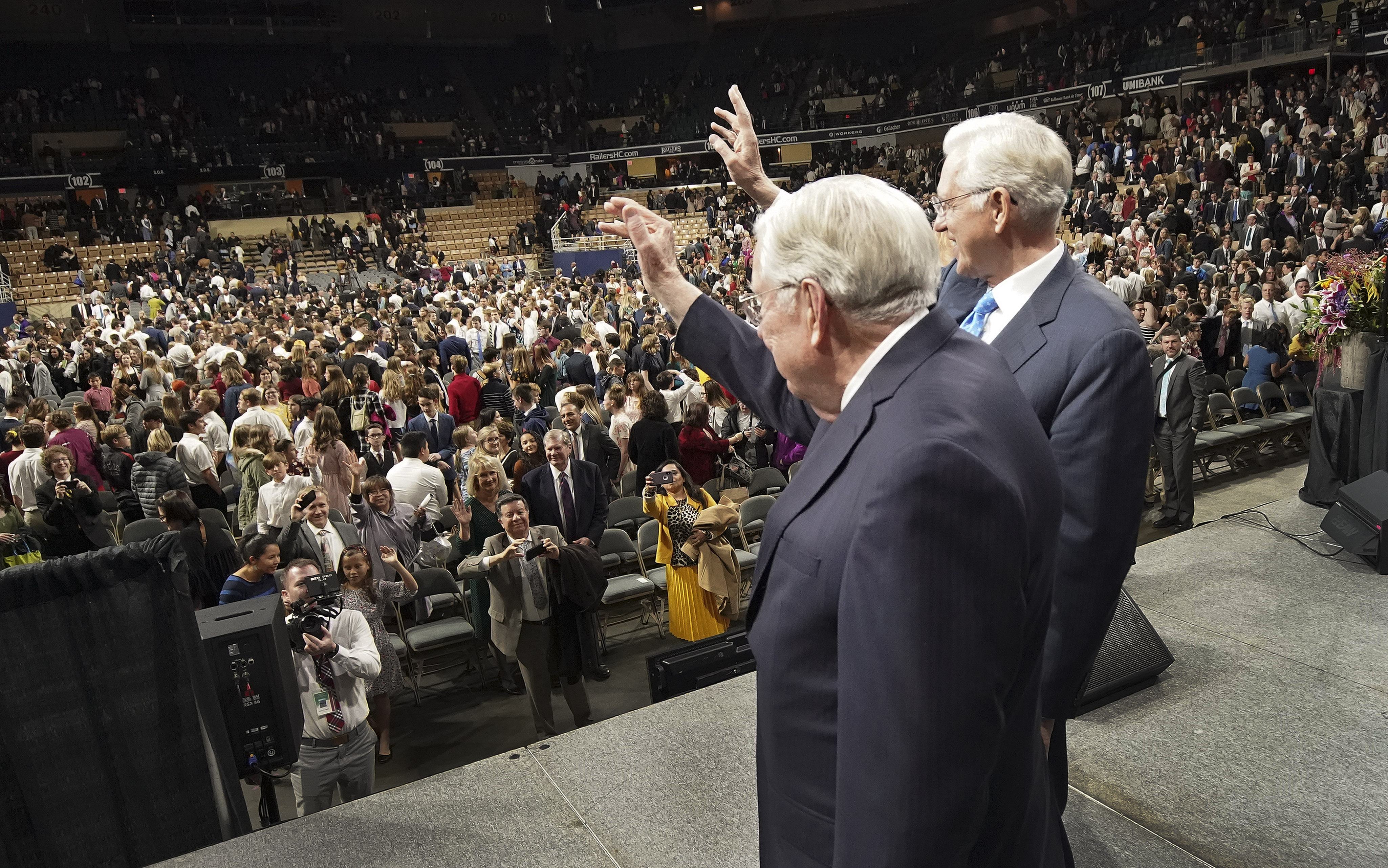 President M. Russell Ballard, acting president of the Quorum of the Twelve Apostles of The Church of Jesus Christ of Latter-day Saints, and Elder D. Todd Christofferson, of the Quorum of the Twelve Apostles, wave to attendees after a devotional in Worcester, Massachusetts, on Sunday, Oct. 20, 2019.