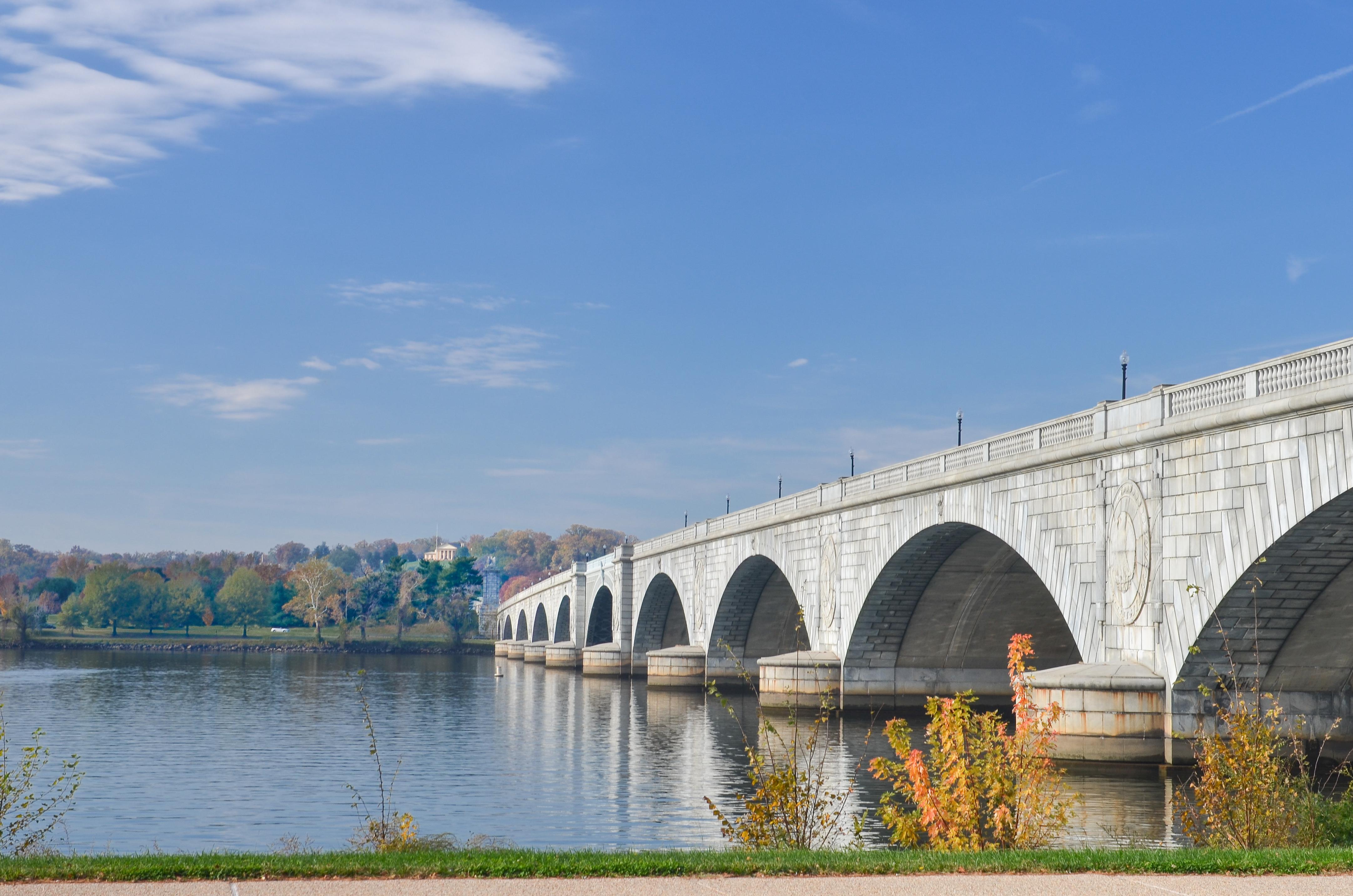A stone bridge across a river. It has large arches.