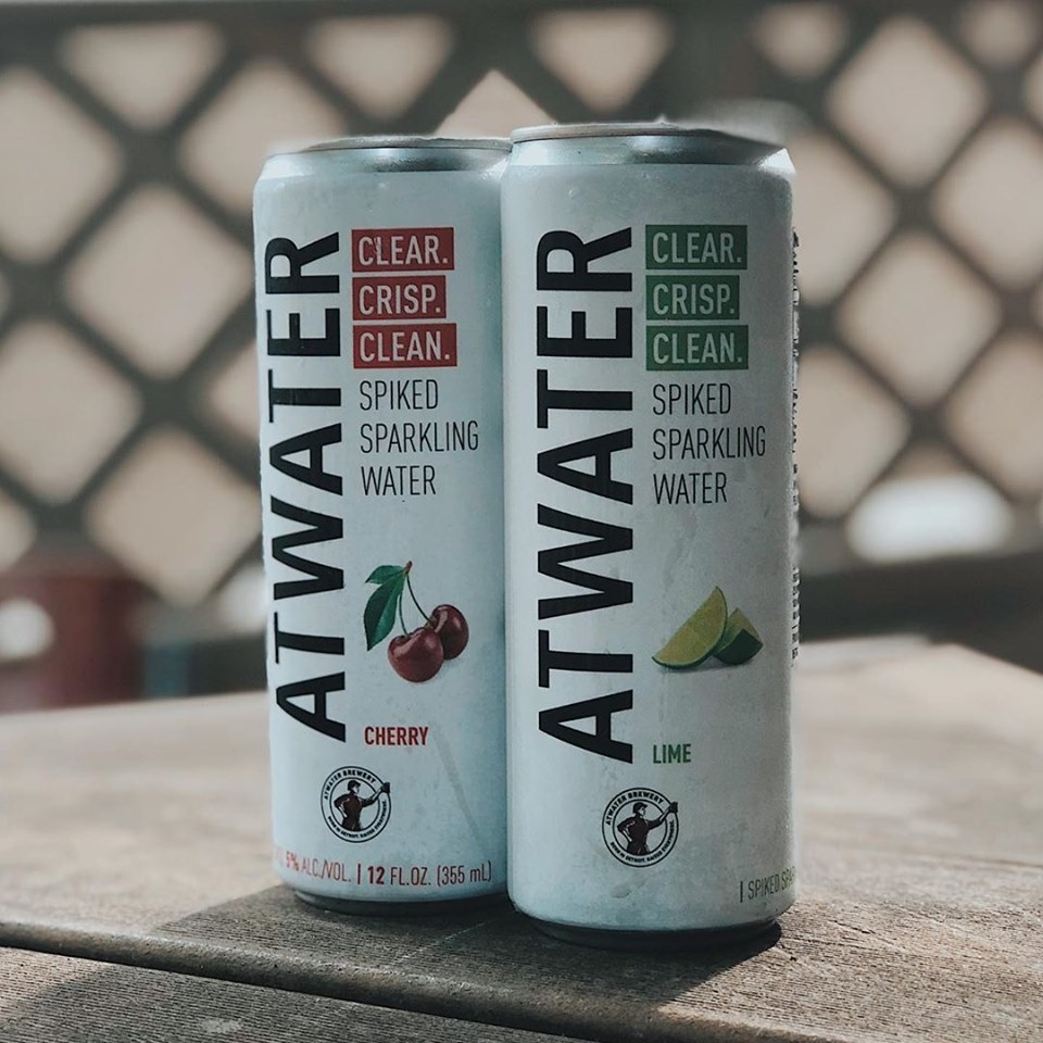Two frosty cans of Atwater hard seltzer.