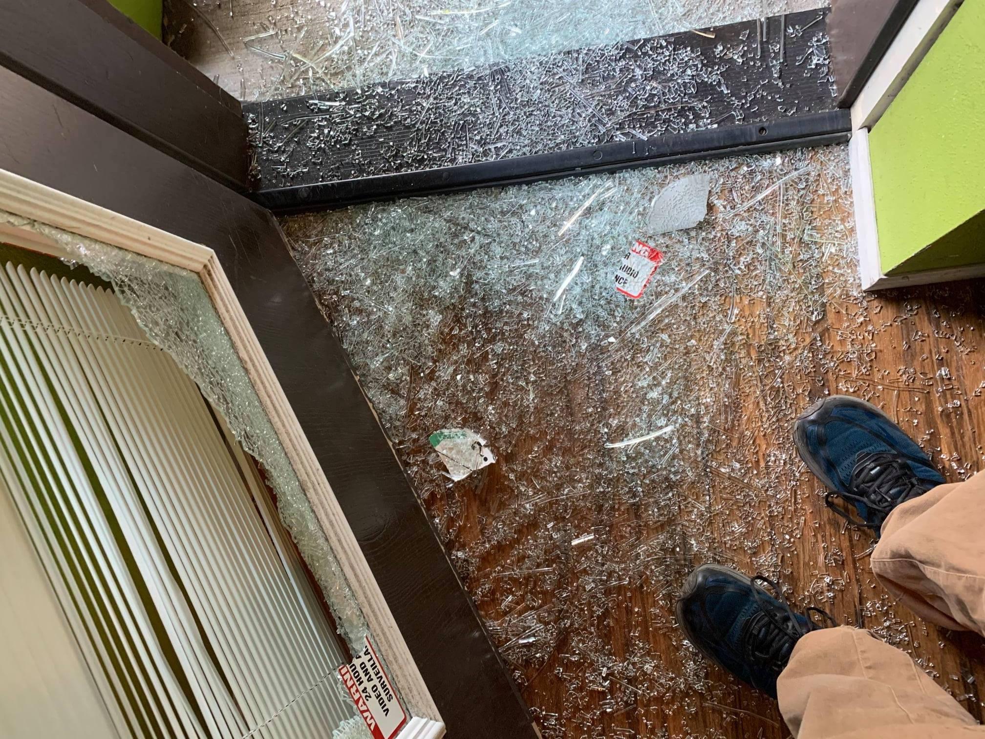 The broken back door of Pairings Wine Shop