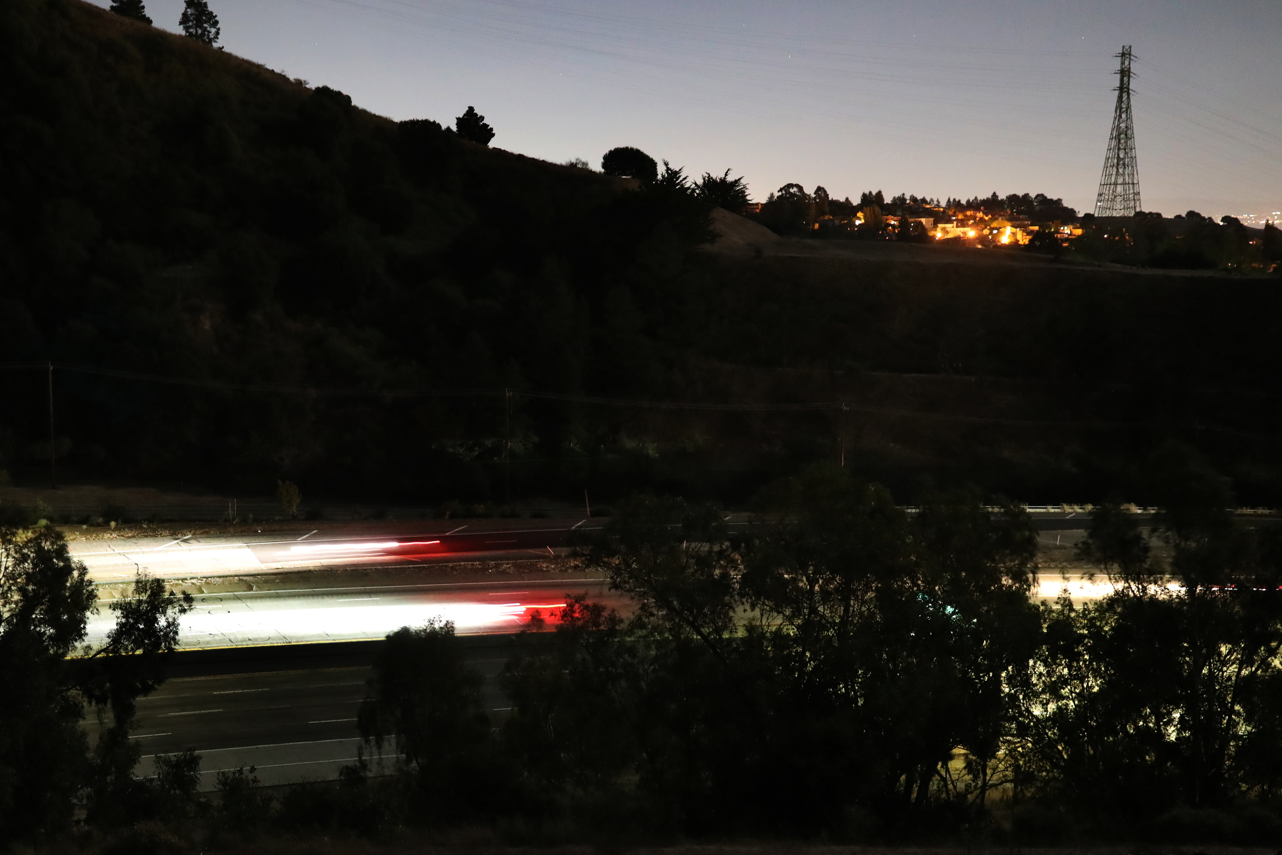 Streaks of lights from vehicles drive along highway 24 during the PG&E power outage in Oakland.