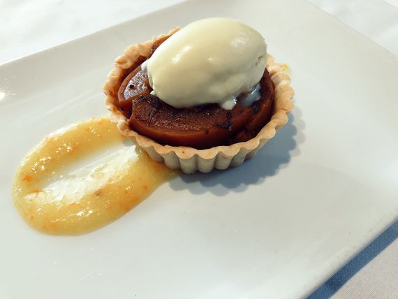 A photo of a plate containing a tartlette filled with pumpkin filling at Bistro Barbès
