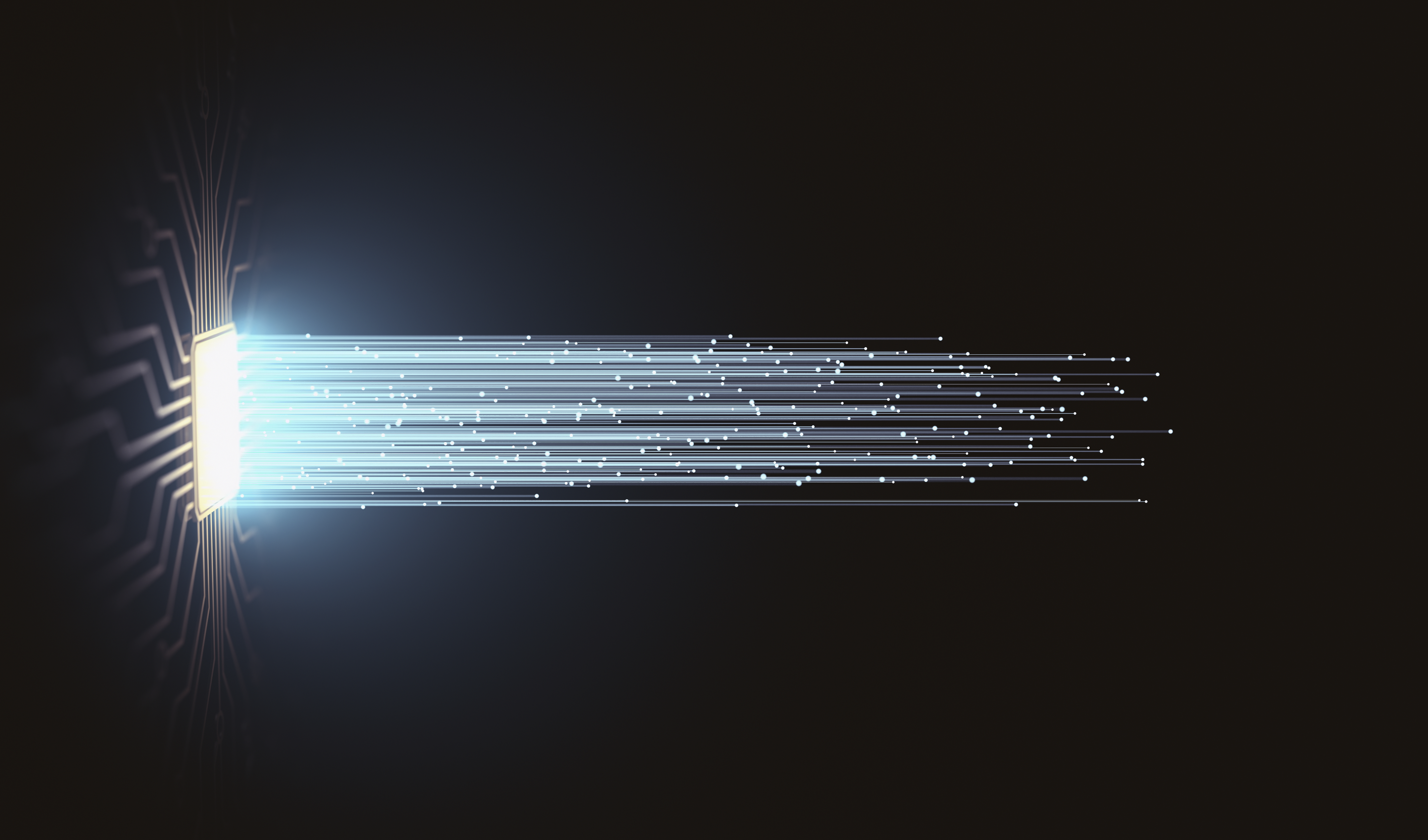 A photo illustration of rays of light extending from a computer circuit board.