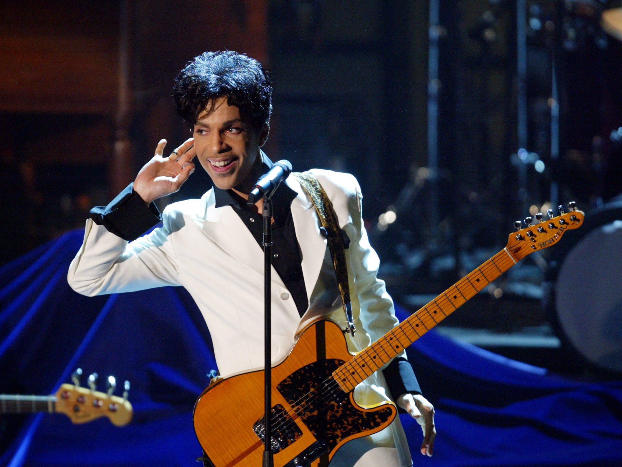 Prince performs at the19th annual Rock and Roll Hall of Fame induction ceremony, Monday, March 15, 2004.  (AP Photo/Wireimage.com, Kevin Mazur/FILE