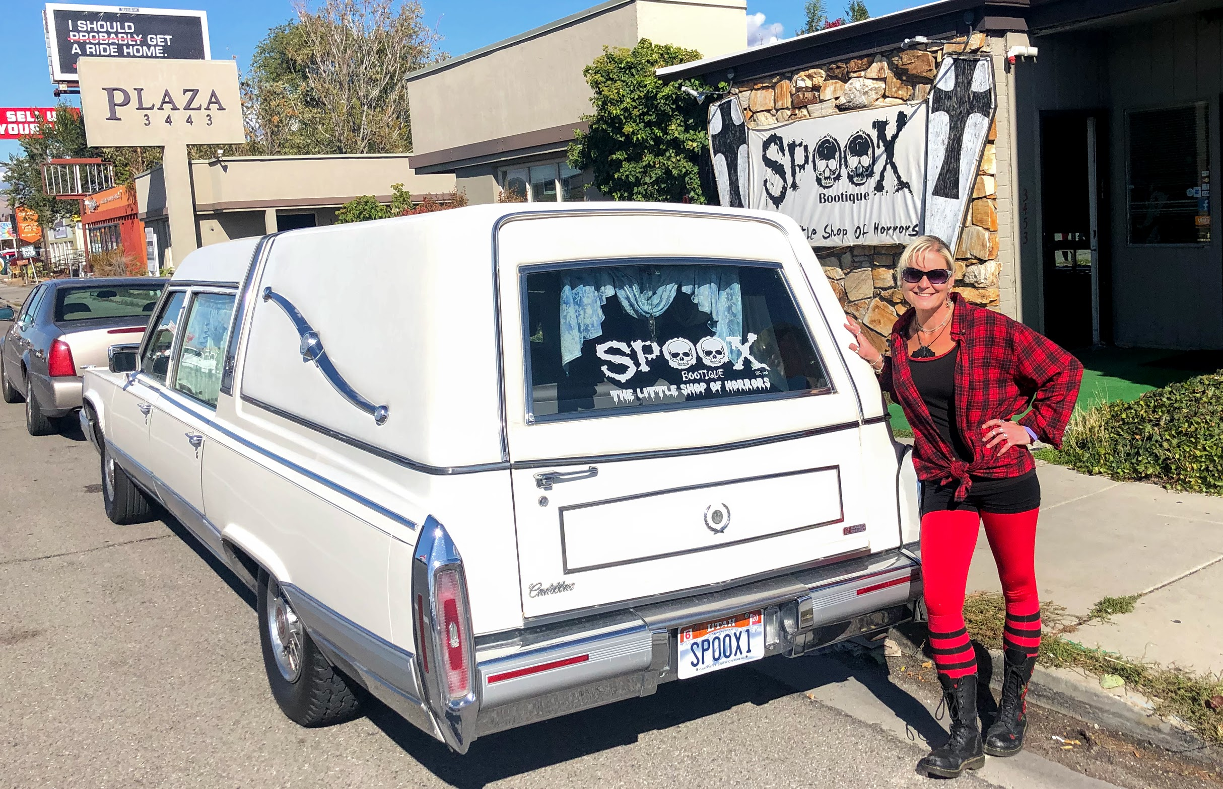 Spoox owner Landrie Miller poses with her hearse outside her store, Spoox Boutique, in South Salt Lake.
