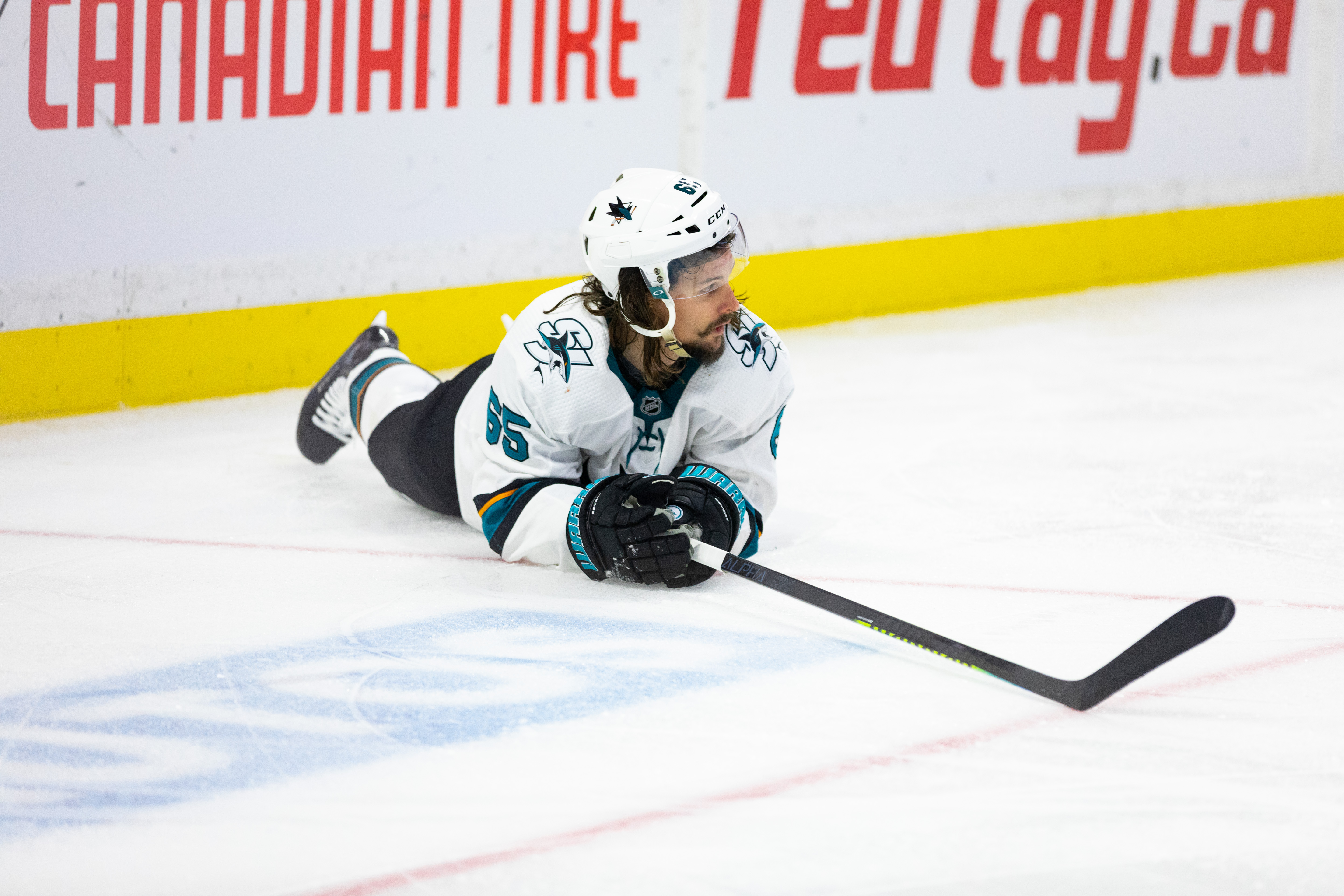 San Jose Sharks defenseman Erik Karlsson (65) lays on the ice after a hit during second period National Hockey League action between the San Jose Sharks and Ottawa Senators on October 27, 2019, at Canadian Tire Centre in Ottawa, ON, Canada.