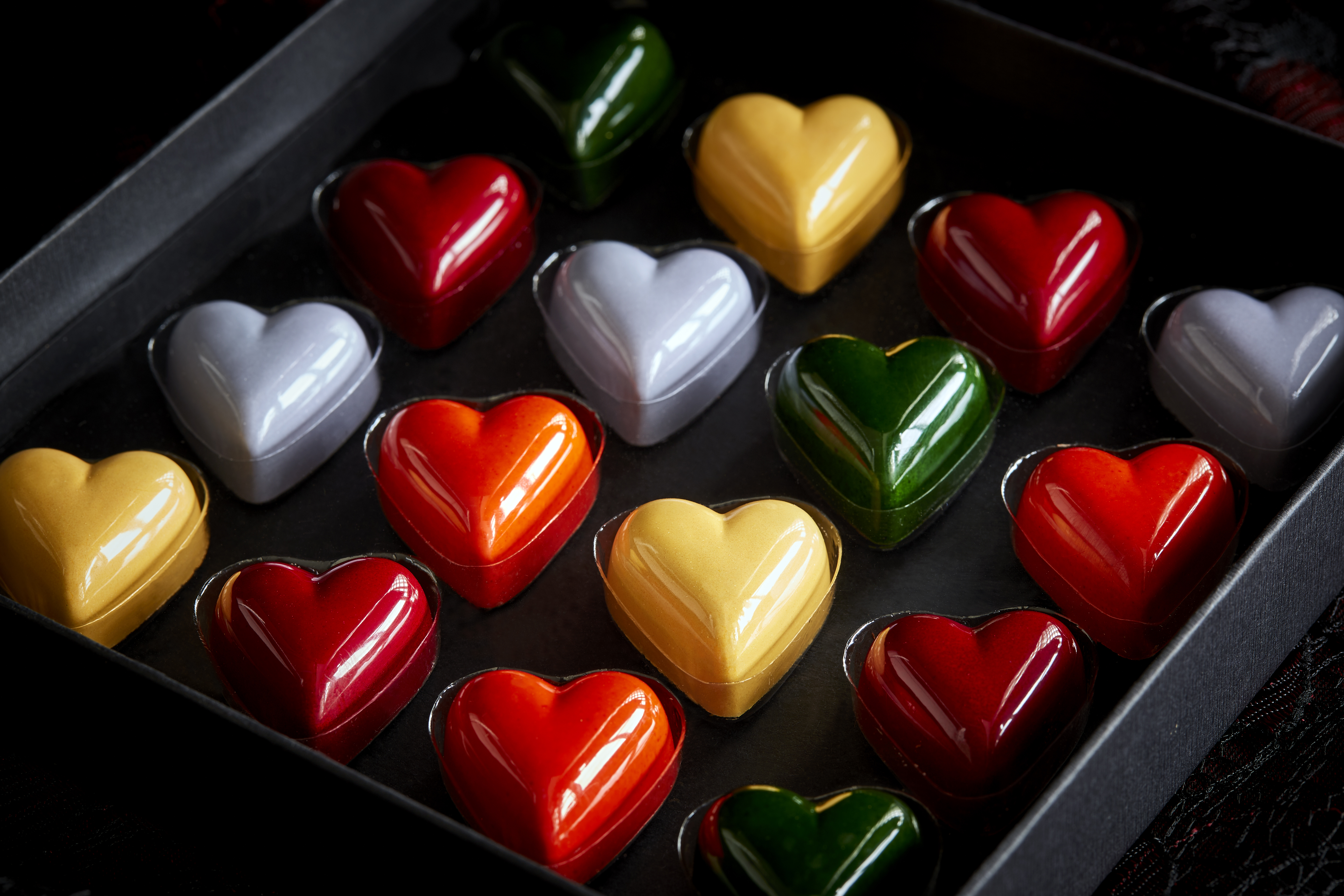 box of heart-shaped chocolates in different colors