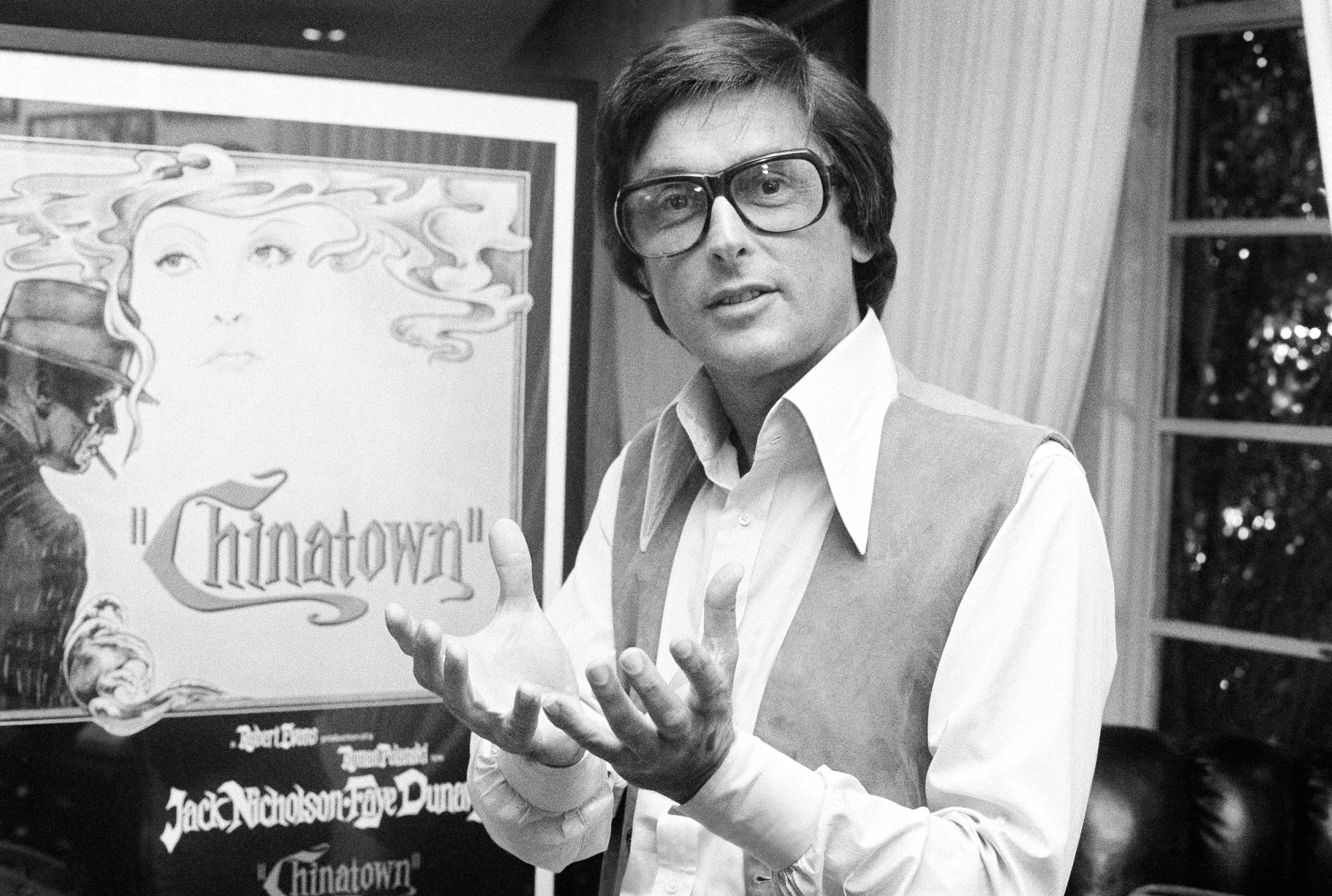 """This 1974 file photo shows Paramount Pictures production chief Robert Evans talking about his film """"Chinatown"""" in his office in Beverly Hills, California."""