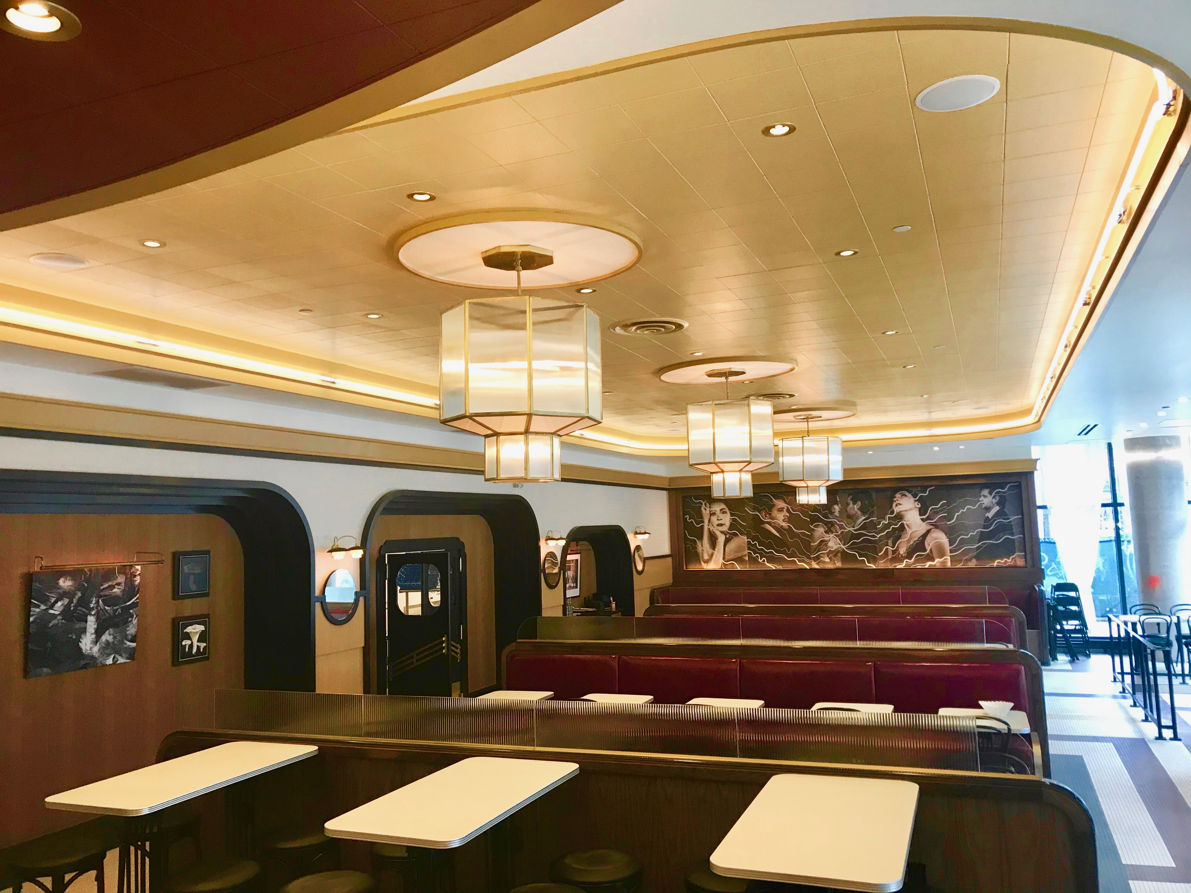 restaurant interior with red booths and art deco design