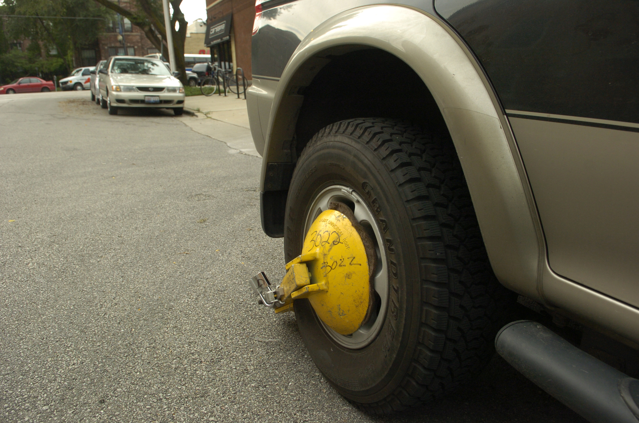 A boot attached to a vehicle in Chicago.