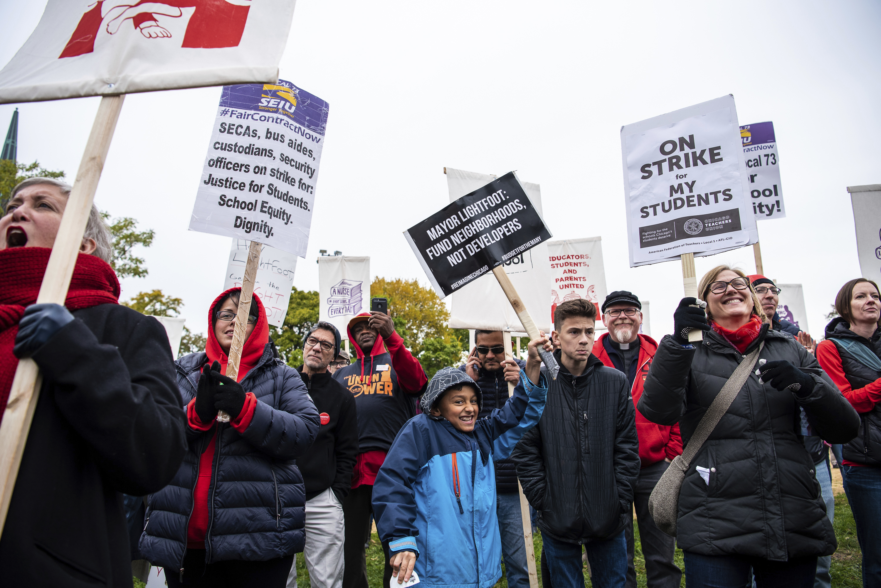 Striking Chicago Teachers Union members and supporters march in Union Park on Oct. 26.