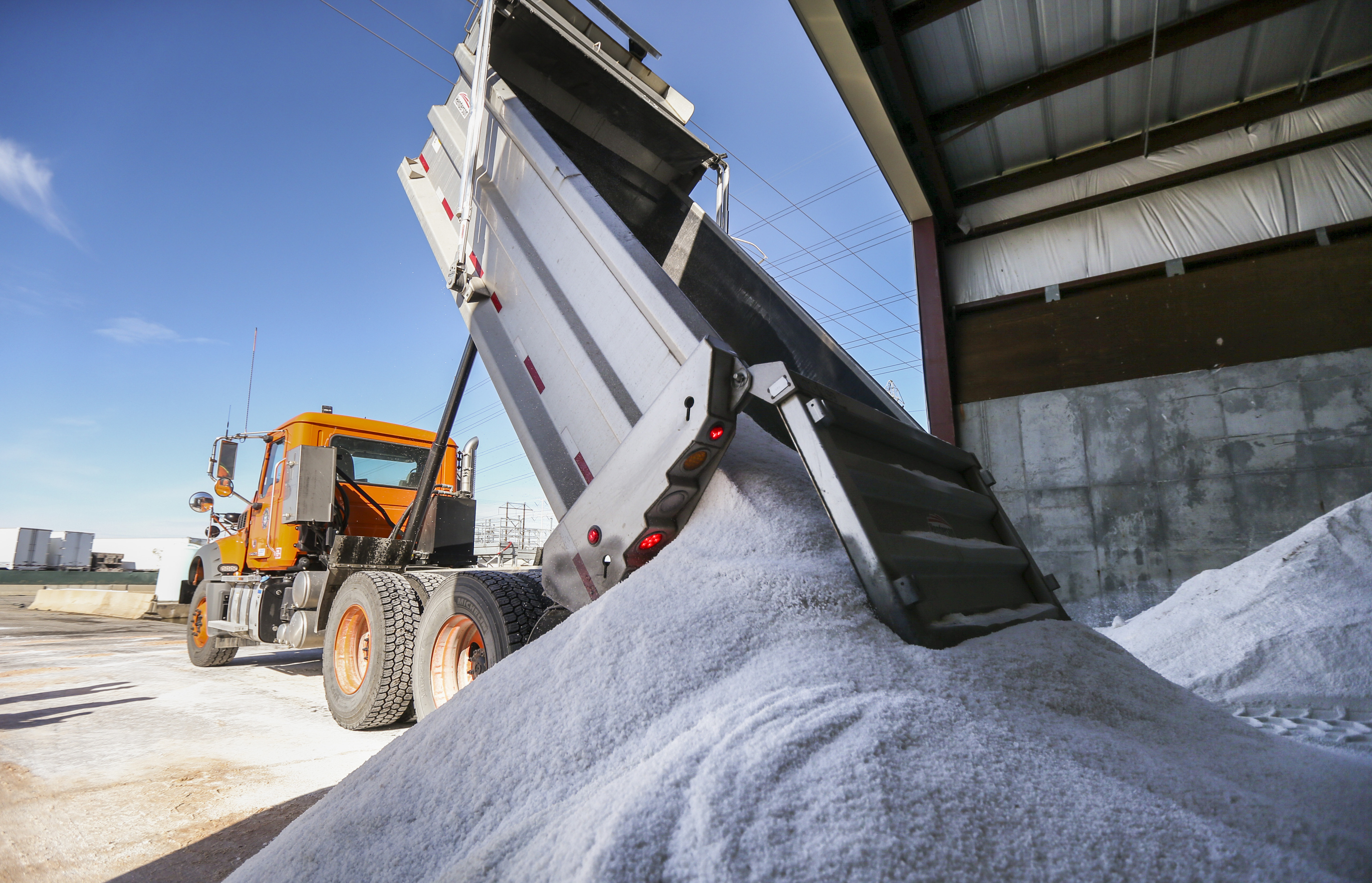 A dump truck delivers a load of road salt to the salt shed at the Utah Department of Transportation's Traffic Operations Center 230 in Salt Lake City on Monday, Oct. 28, 2019. A wintry storm is expected to hit the Wasatch Front Monday night into Tuesday.