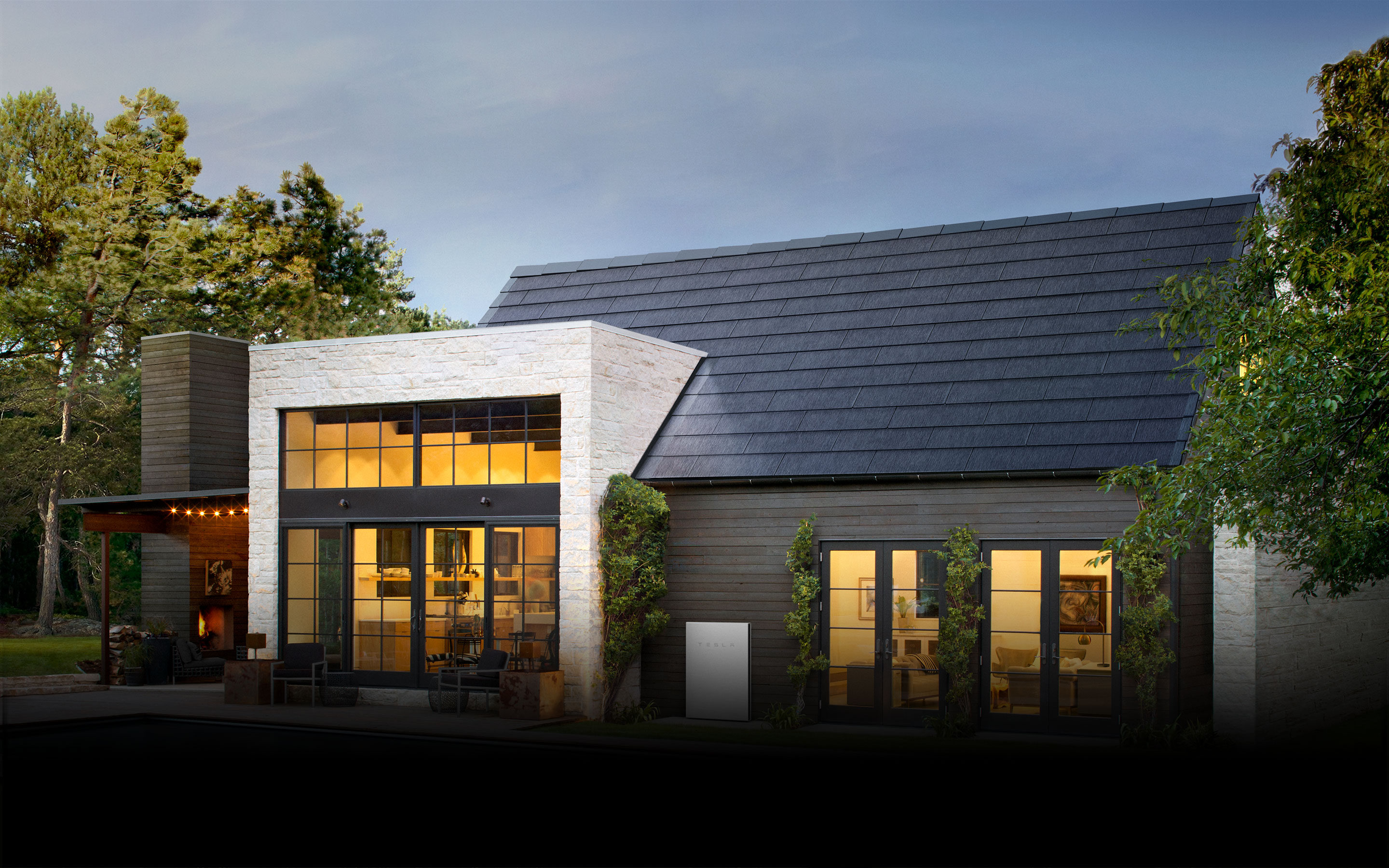 Rendering of house with solar roof tiles on a pitched roof.