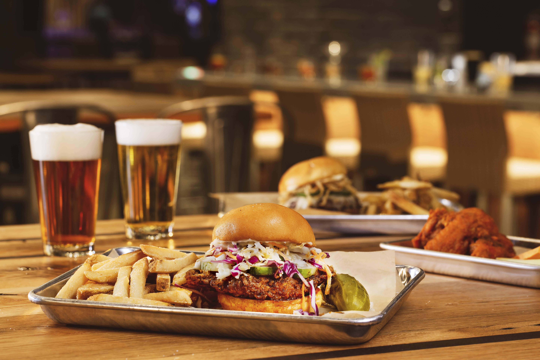 Beer surrounding a chicken sandwich