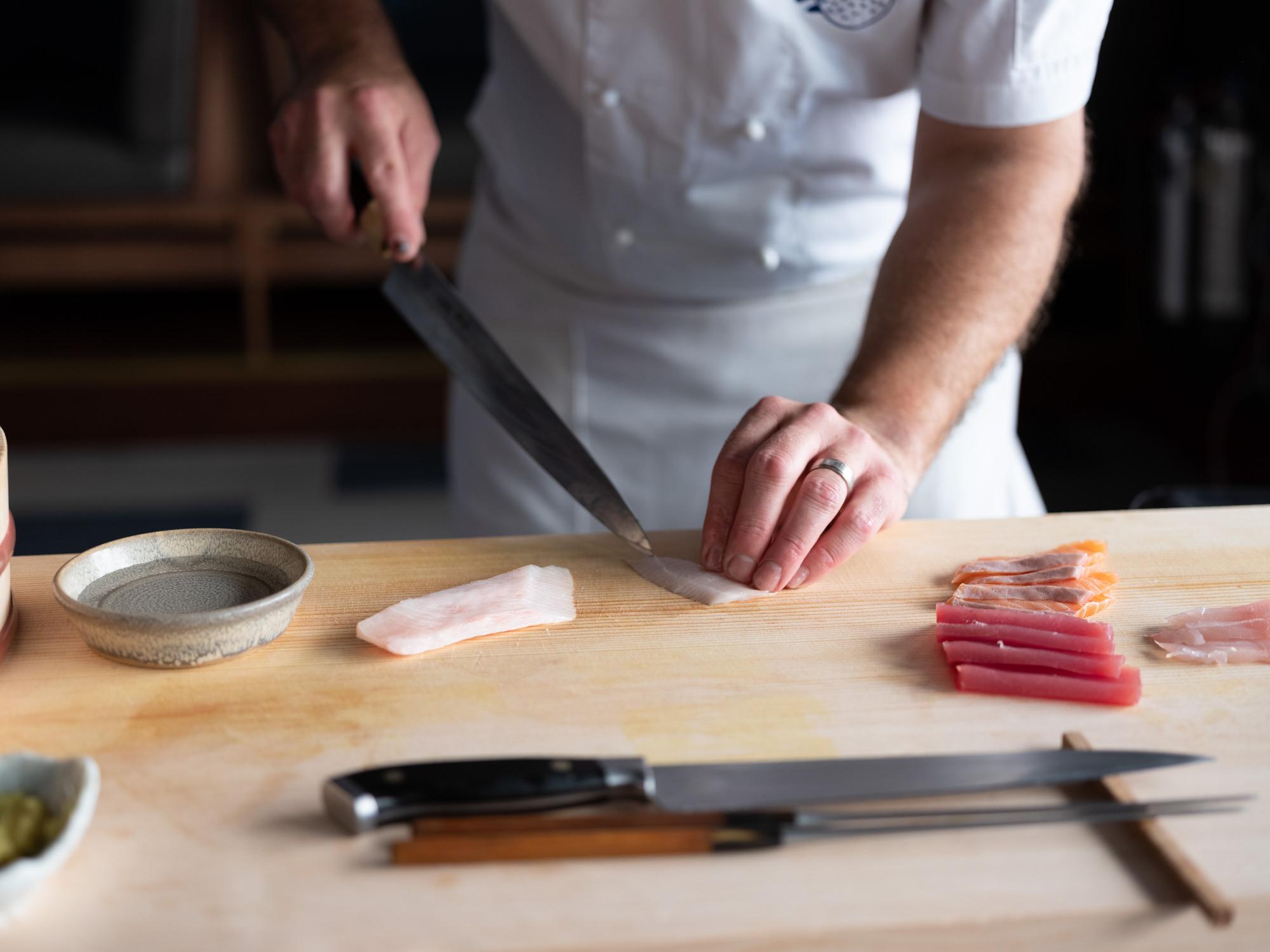 Australian Shuan Presland cuts raw fish. He will open Pacific at number 10 Heddon Street in Mayfair in November 2019