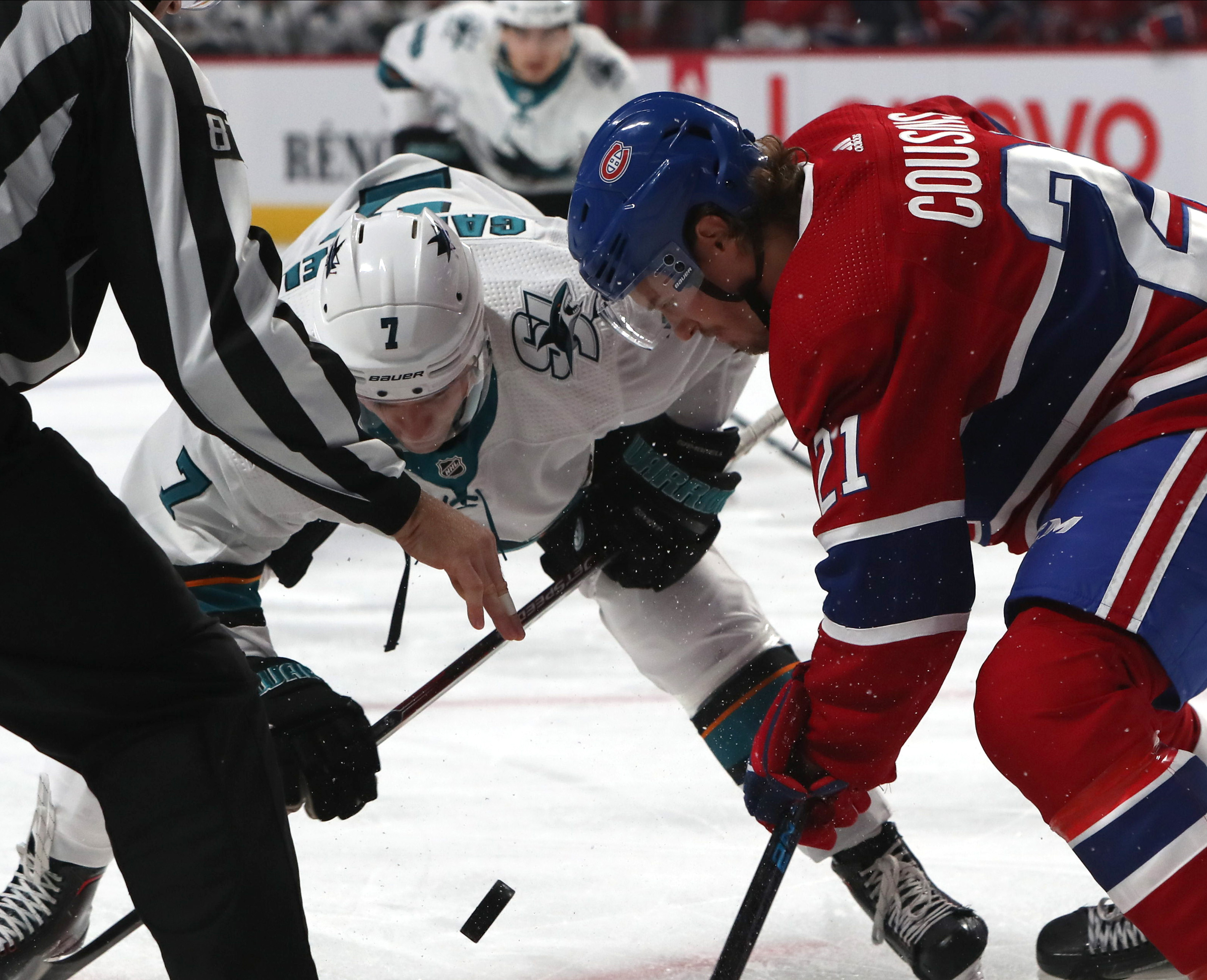 Oct 24, 2019; Montreal, Quebec, CAN; San Jose Sharks center Dylan Gambrell (7) and Montreal Canadiens center Nick Cousins (21) during a first period face-off at Bell Centre. Mandatory Credit: Jean-Yves Ahern-USA TODAY Sports