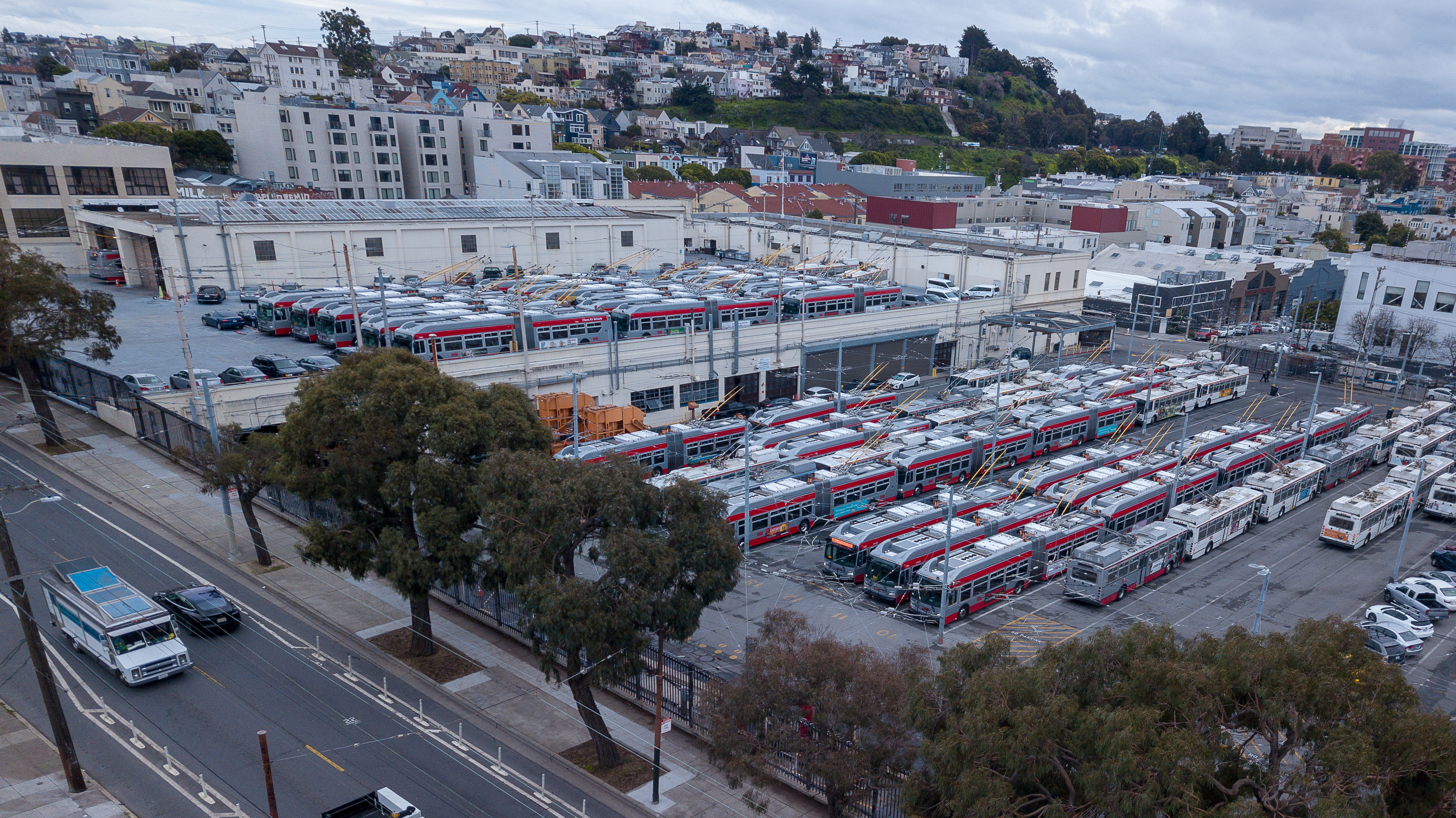 A big parking lot full of commuter buses.